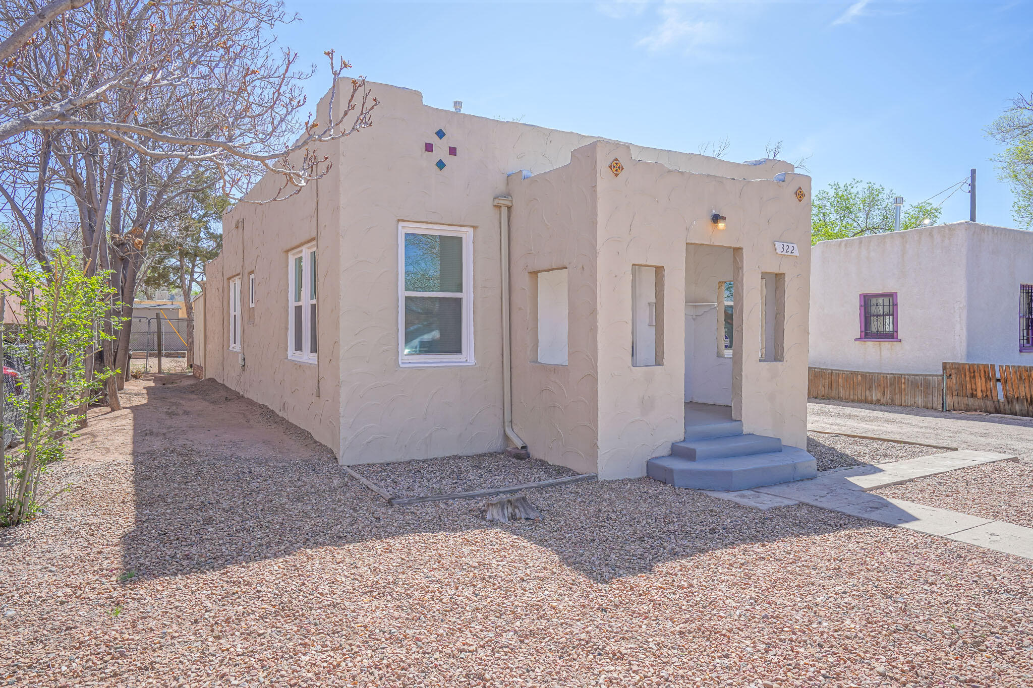 Totally updated 3 bedroom 1 bathroom home in the UNM area.  Freshly painted, newly stained oak wood floors. New kitchen cabinets, New fridge, gas range and overhead microwave.  Stacked washer and dryer.  Brand new Aero Cool 12'' evaporative cooler.  New forced air gas furnace installed in 2019 along with new 40 gallon water heater.  Updated 100 amp electrical service and additional blown in insulation.  New roof on garage and patio cover.  Zoning allows for additional units on this lot.
