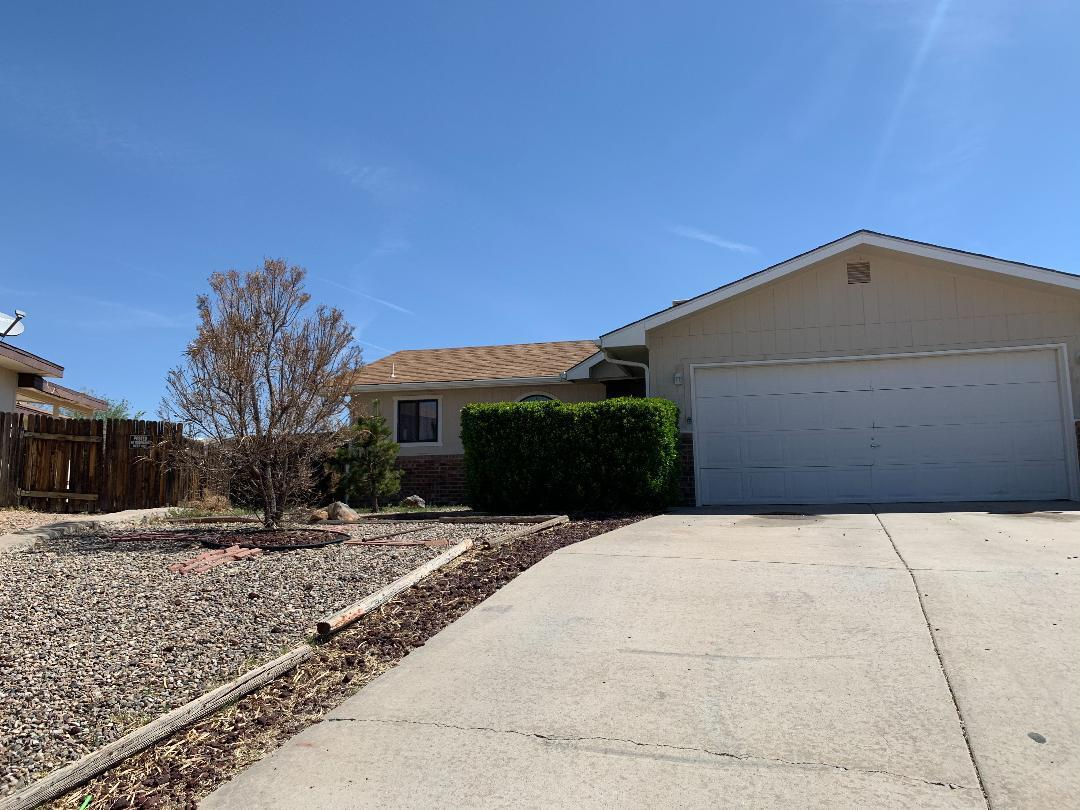 Super Cute Home located minutes from UNM Valencia Campus, Modern Grey & White colors, Tile & Laminate flooring throughout, Split floorplan, Cozy Gas log fireplace, Amazing 15 x 16 tile sunroom, great for relaxing or game room, (Sq. ft. is NOT included in square footage) Large 1/4 acre lot, perfect for entertaining!