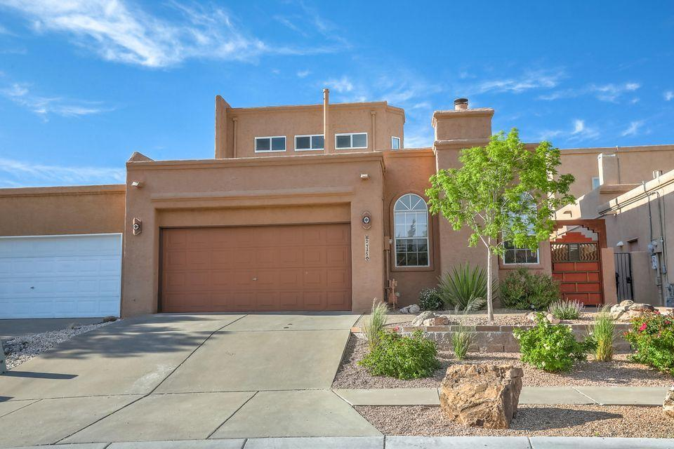 RARE FIND! Stunning & Spacious 3 Bed, 2 Bath Townhome in one of the Most Desirable neighborhoods in Albuquerque, Heritage East (La Cueva School District). Short walk from Quintessence Park & part of an Amazing community. Large kitchen free from narrow pathways! Upggraded Gas Stove, Double Oven & Microwave. Tons of concealed pantry space. Large & Open Living and Dining room with Lovely Gas Fireplace.  Roomy Loft w/ Spectacular Views.  All bedrooms on ground level which means stairs are optional in this house! Large Master Bedroom & Bath. His & Hers closets. New water heater (2021), New garage opener (2020), almost new carpet. Cozy, low-maintenance back yard.  Jaw-dropping Views from Balcony. 2 Fruit Trees featuring Pears and the Sweetest Nectarines you've ever tasted!  Don't Miss this Gem!