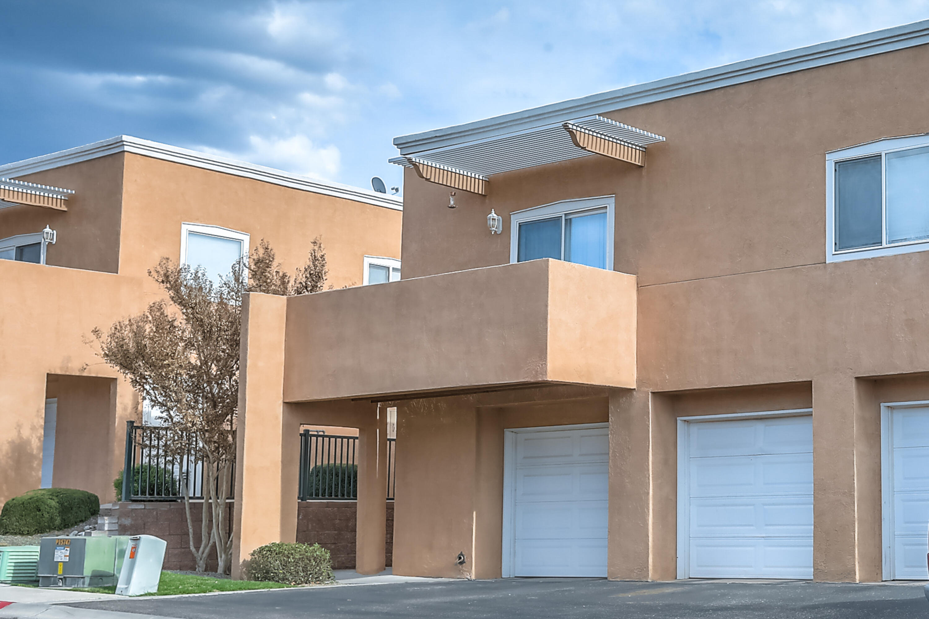 This is a lovely condo in the gated Oso Park neighborhood.  It has a nice open concept with 2 bedrooms and 2 bathrooms.  The living room also has an outdoor patio with incredible views of the Sandia Mountains.  In the kitchen you'll find a breakfast nook, bar area ,gas range, and a large walk in pantry.  The MasterCool unit is new and so is the dishwasher and a new foam roof was put on in 2017.  The seller is willing to leave the washer and dryer also. The HOA covers the common area greens, the roof, insurance, the water bill, the streets, and gate.  This unit is upstairs with a 1 car garage below.  There is not a yard but there is a ton of great landscaping and small parks in the community.  It's walking distance from CNM, parks, restaurants and more!