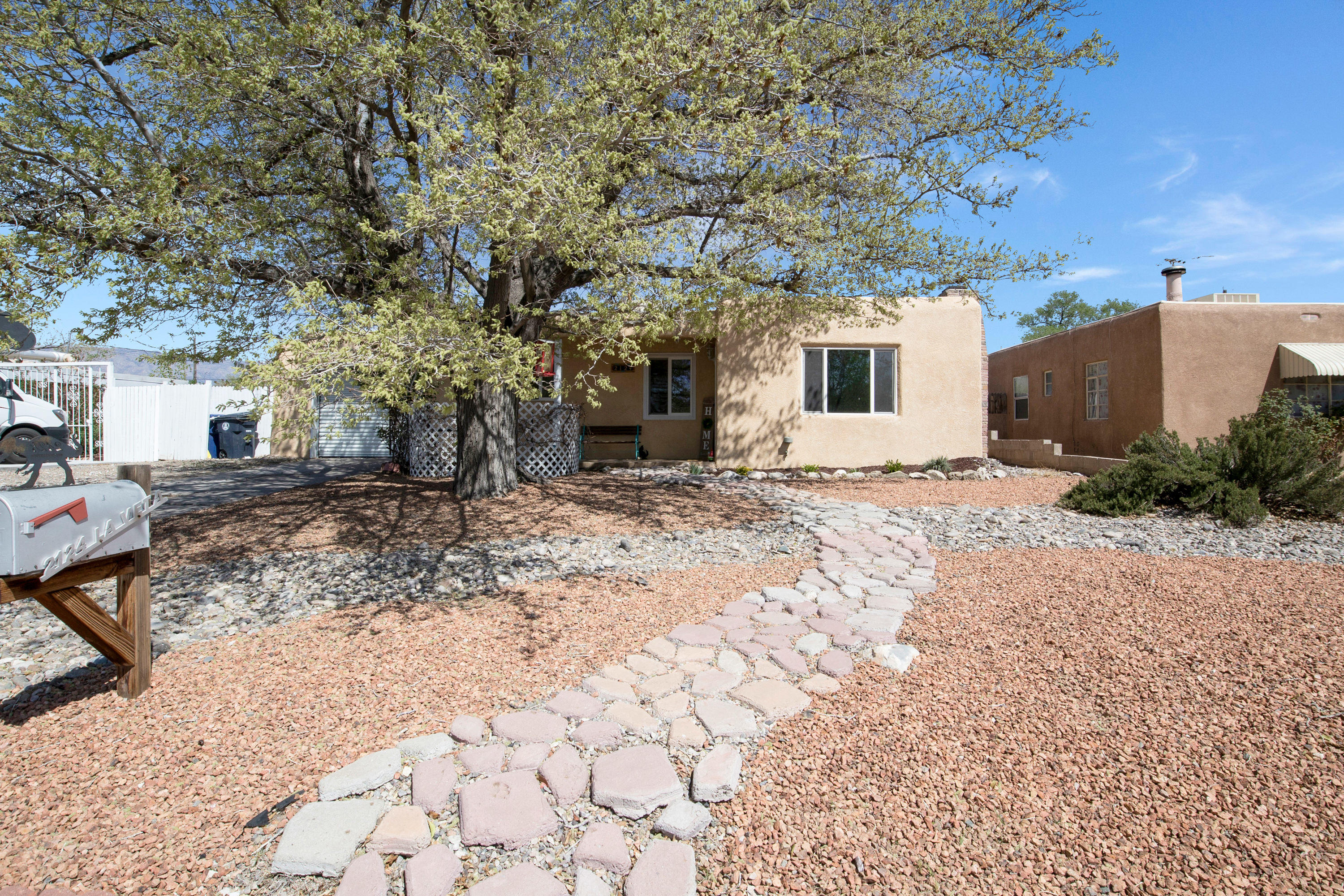 *Offer Deadline: Sunday, April 18th at 2pm*This home is adorable! Get ready to be smitten. From the moment you pull up, you're greeted by an old growth tree and a low-maintenance, xeriscaped front yard with gorgeous shrubbery. As you walk in, you'll feel immediately at home in your cozy living room with a wood-burning fireplace. The galley-style kitchen features fun custom tile designed countertops. Two well-appointed bedrooms share a nicely updated full bathroom. The garage conversion provides extra space for a proper den, workshop, or maybe an in-home gym! Being so centrally located to all that Albuquerque has to offer is such a treat. Within minutes, you can be in any part of the city - just catch I-40 in either direction, and off you go!