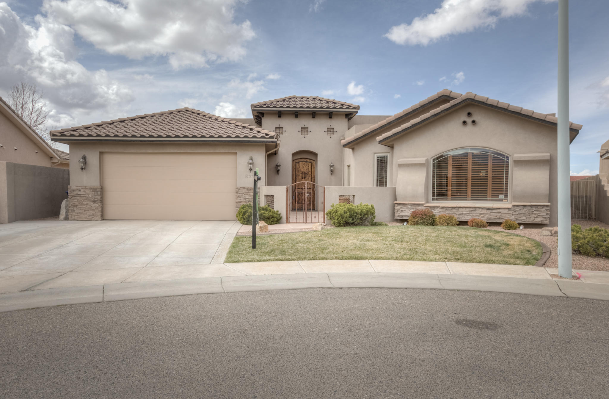 This 4 bed, 3 bath home boasts 3275 sqft, a spacious open floorpan with lots of upgrades! Located in a quiet cut da sac lot, this single story custom home has a private court yard entrance with amazing curb appeal. Once inside you're greeted with a spacious entry way, a great room with vaulted ceilings. Open living area, crown molding and a custom built entertainment center. Overlooking the living room is the chefs kitchen equipped with built in stainless range, hood, massive granite kitchen island and beautiful staggered wood cabinetry. Off the open dining room is a wet bar. The large master suite has patio entrance with a separate bath and shower. Guest bedroom has jack and jill bath. Guest bed also has a its own bathroom. Huge laundry with custom cabinets and granite countertops.