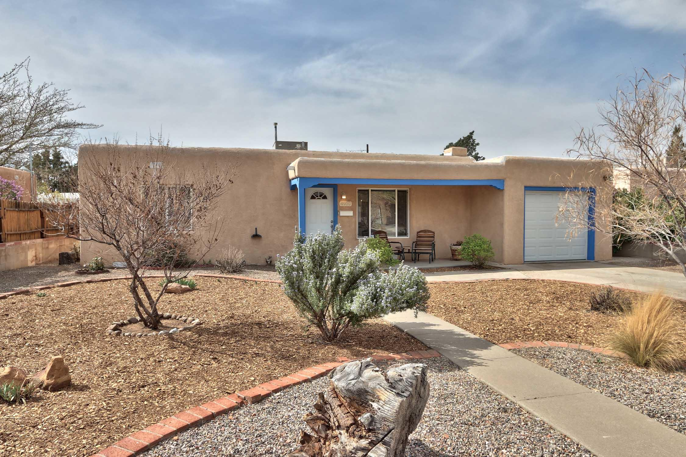Darling UNM area home with beautiful light, open floor plan, refrigerated air, large den and hardwood floors. Kitchen has been upgraded with granite countertops and stainless steel appliances. Large master sits in separate wing from 2 additional bedrooms and has French doors that open to ample-sized backyard w/ raised beds, perfect for entertaining, gardening or relaxing. Large storage shed in backyard  for gardening tools & implements. Master bath features walk-in shower and updated counter tops and double sinks. Fresh landscaping and new fencing add to the ambience. Ideal location, close to Altura Park and all amenities, including shopping, UNM facilities, hospital, Nob Hill and Kirtland. A true gem in the middle of the city!