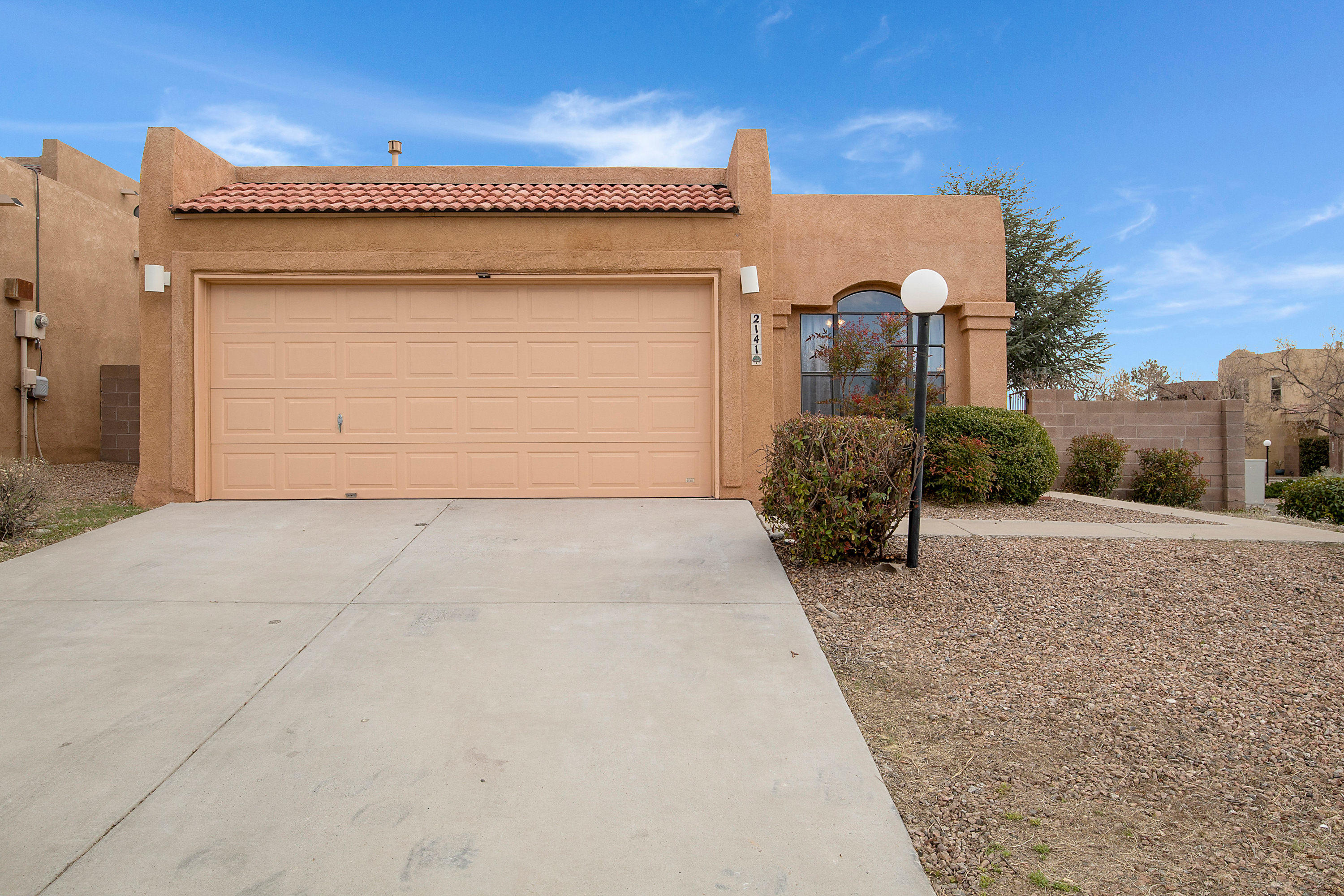 Come See this Beautiful Sandia Heights home on a corner lot! Enjoy the raised ceilings, laminate flooring, granite counter tops, corner fireplace and hand peeled vigas in the entry. This Southwestern charmer is close to trails for hiking, biking, or walking, sits in quiet neighborhood and has an abundance of natural light!