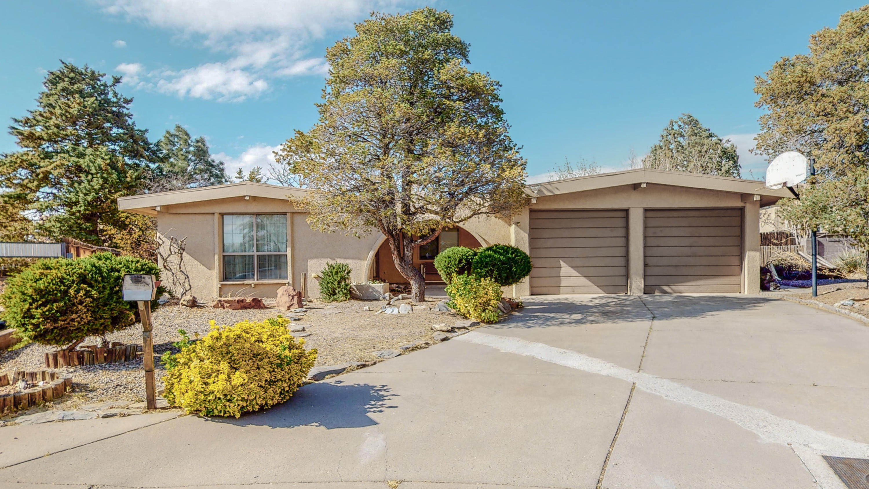 Great Choice on a quiet cul'de'sac. Two Living Areas ---one with wood-burning Fireplace. Galley Kitchen with Breakfast Bar and Adjacent Dining Room. Family Room that opens to a Covered Deck and Large Fenced Yard. Dog Kennel and Storage Building are Fenced Separately. Convenient Location for shopping, schools, entertainment & more.*Click on second photo for virtual tour.*