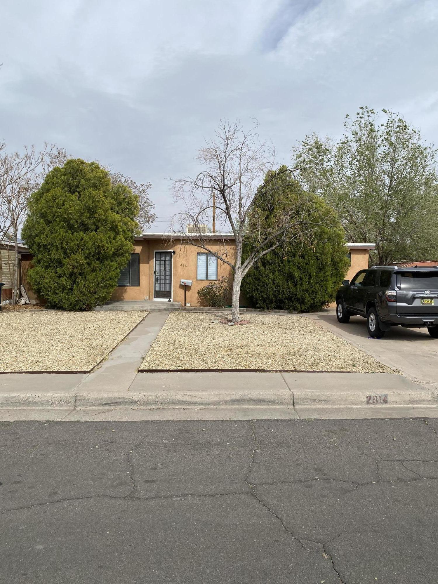 wonderful 3 bedroom 1 3/4 Bath home  new flooring, paint, lighting cozy little home with a fireplace in great room with a wide open kitchen with island and a small study.  Also a two car detached garage that needs to be converted with new door or a nice shop or casita so many possibilities