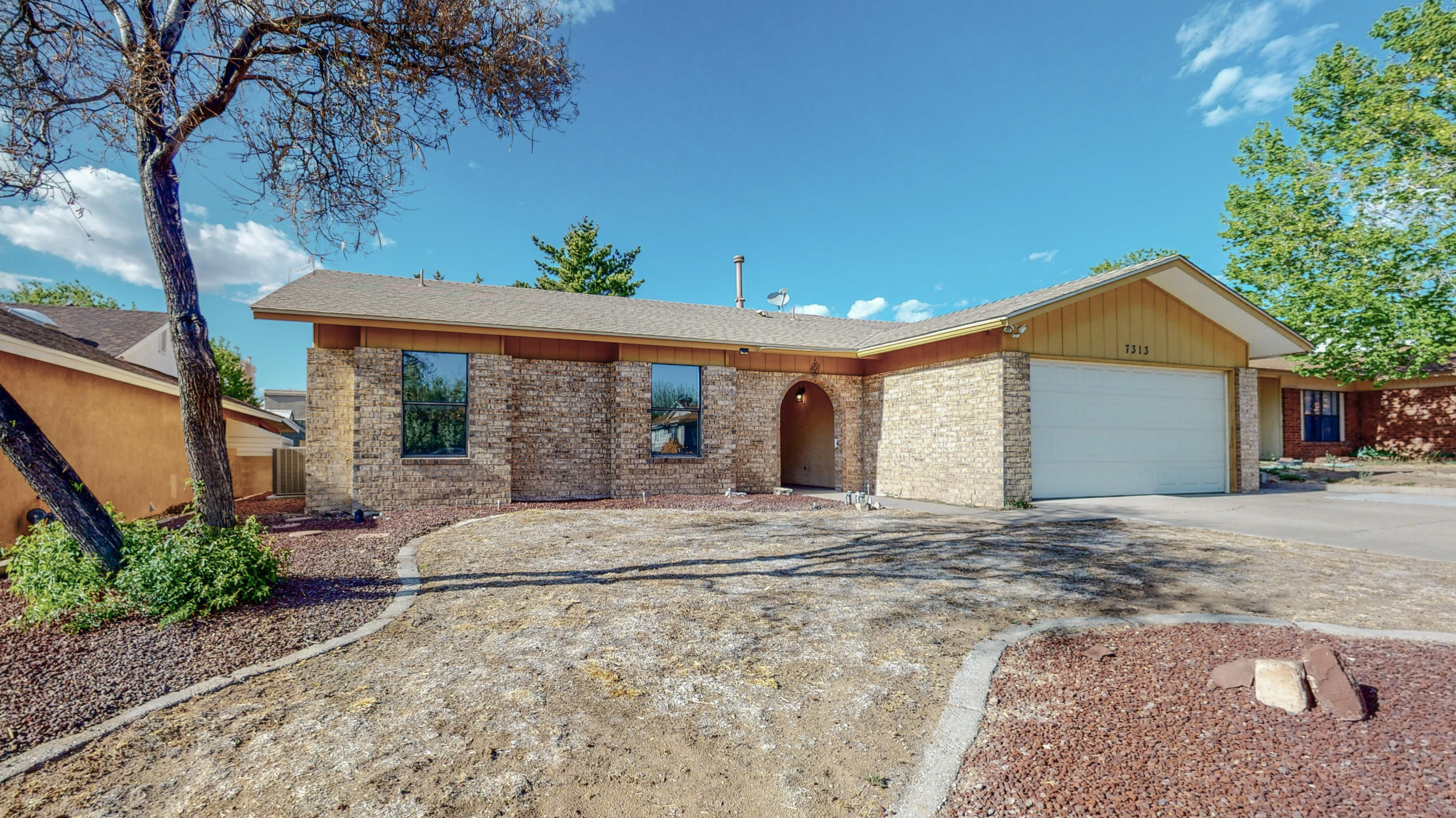 Don't miss this sweet single story home in a wonderful neighborhood just a stone's throw from I25 and all the shopping and amenities along Paseo del Norte. Enjoy a nice snooze in your roomy master bedroom and when you're up and around you'll get your kicks in a great living area layout that includes a separate dining room and updated kitchen with stone counter tops. There's a wood burning fireplace to toast your toes in the winter and a nice covered patio for those cool summer evenings. The rear yard has plenty of room for some reimagining and would xeriscape nicely. Roof and HVAC with refrigerated air both replaced in 2015. Water heater replace 2020.