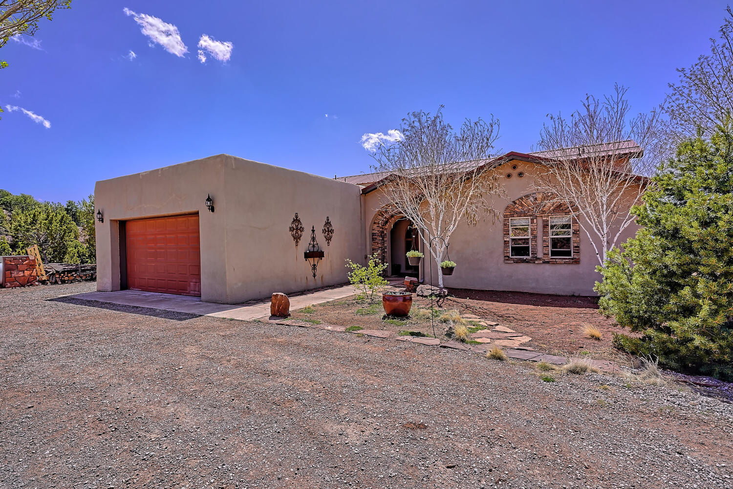 OPEN HOUSE 7/25 1-4pm Gorgeous 1 story custom home on 2.8 acres with stunning views. Enjoy the peace and seclusion this home has to offer in its private gated community only 10 minutes from ABQ. The entry way greets visitors with Travertine tile and an ornate mosaic medallion. The flowing floorplan opens out into the spacious Great Room with commanding picture windows for you to enjoy  fabulous mountain views. The kitchen is an entertainers delight with plenty of countertop space, cabinets and room to move!  It features granite countertops, maple cabinets, slate backsplash, bar seating, stainless steel appliances and an island with prep sink. Quality of construction and attention to detail throughout. New Well 2019, New Roof 2019, New Septic 2021 An additional 21 acres is available.