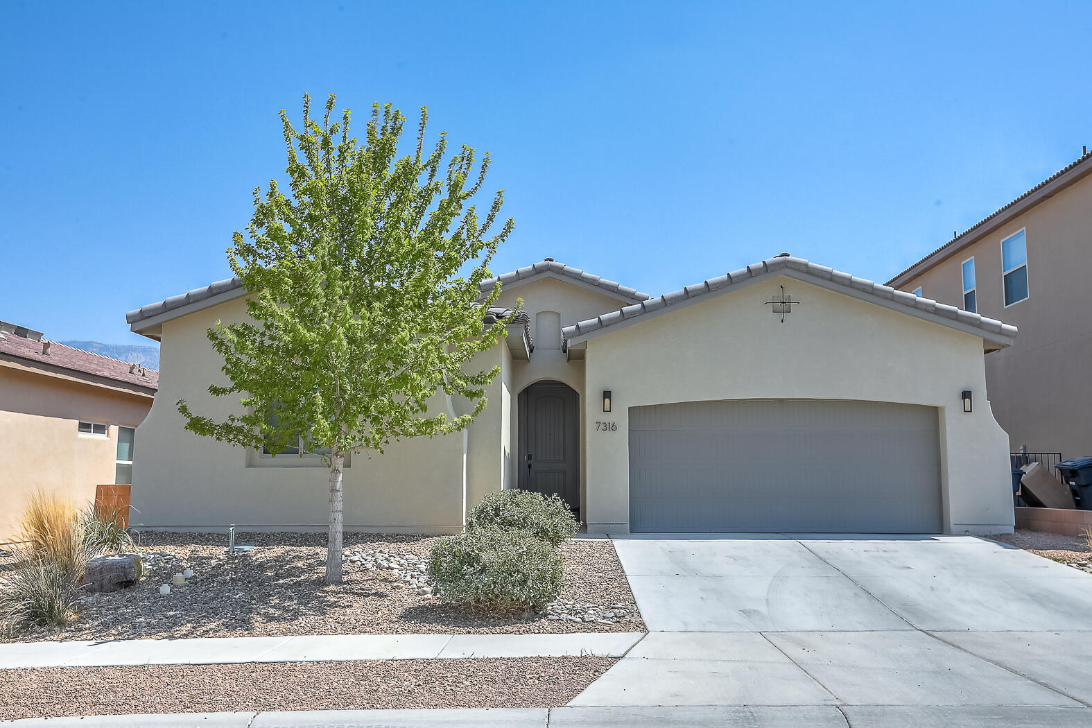 This beautiful Abrazo home is only 4 years old and boasts several lovely amenities! You'll enjoy the open and bright floor plan. In the kitchen you will find stainless steel appliances, granite counter tops, an island, and a large walk in pantry. Each bedroom has its own remote for fan/light use and 2 inch blinds. The spacious master has a separate glass door shower and tub, a double sink vanity, and a huge walk-in closet. There is 18 inch tile through out the home, oil rubbed bronze fixtures, and nest air controls. The finished garage can fit 3 cars with 1 tandem or you could use the space for a workshop or extra storage. This smart home has USB outlets, and access to lighting, air controls, front door unlock/lock features through the Vera Home app.