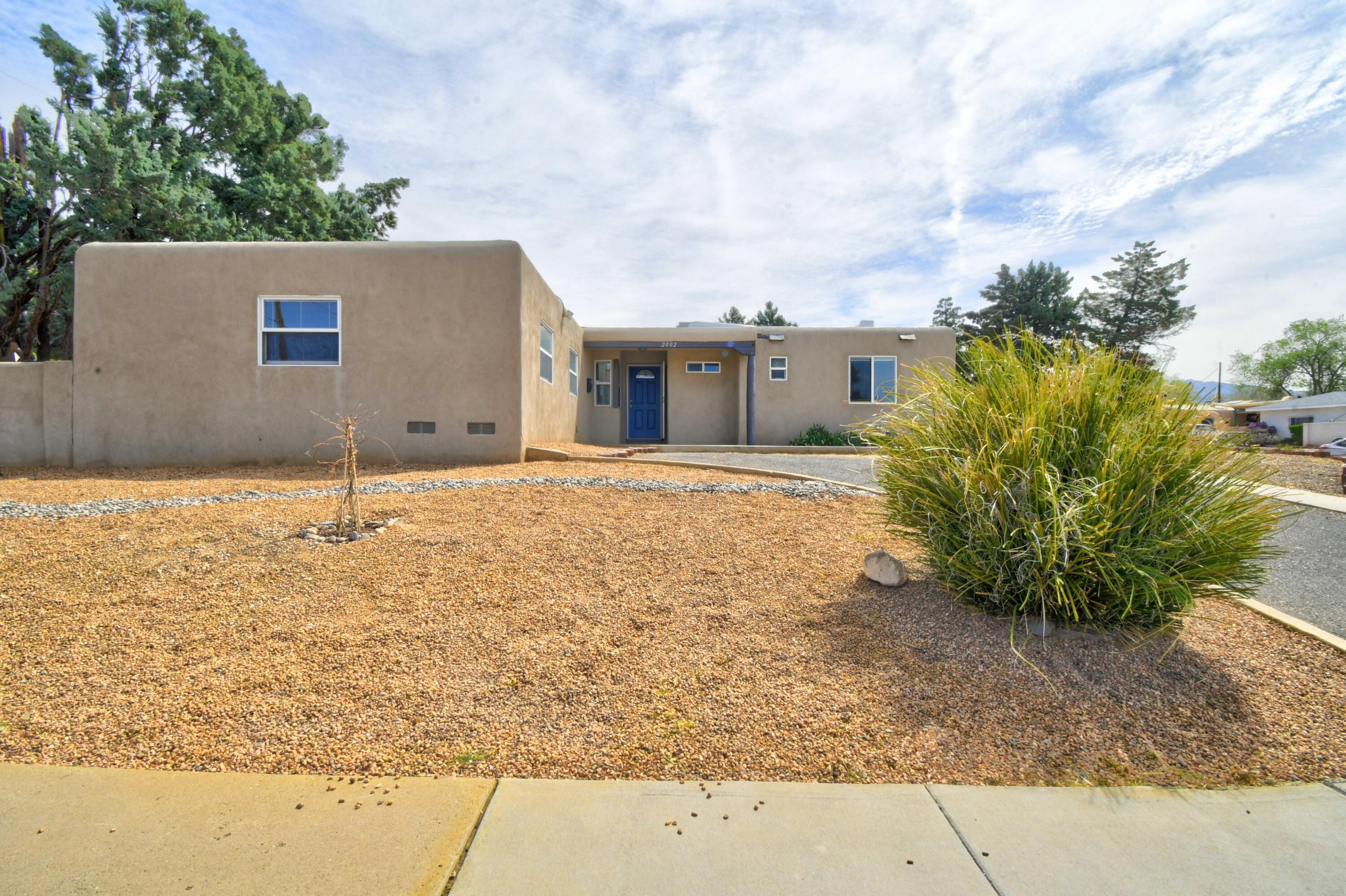 Beautifully updated 3 bed/2bath home on a corner lot in the NE heights. This home was first updated in 2015 with new flooring, windows, bathrooms, paint, stucco, doors, ceiling fans, kitchen cabinets, countertops, sink, appliances and a heat/cool combo unit. In 2021 a new roof was installed along with new flooring. You will say wow!