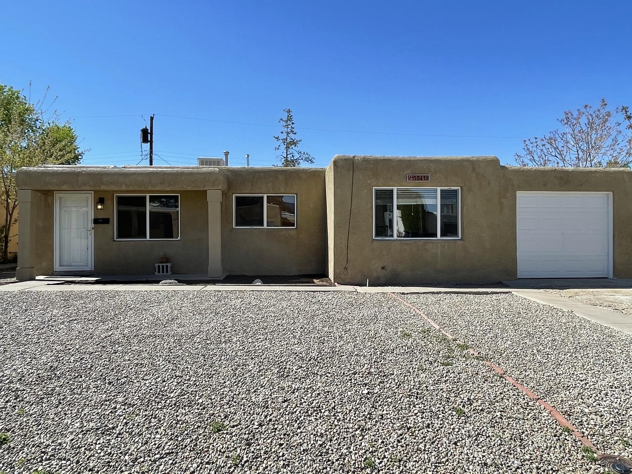 Bran spanking new roof!  Come check out this 4 bedroom home available near Menaul Blvd NE and Morris St NE!  No HOA, no carpet!  Large master with walk-in closet. Open kitchen with plenty of cabinets, stainless steel appliances, separate laundry room, large landscaped yard, & newer windows!  Separate fenced run in the backyard!   Come check it out!