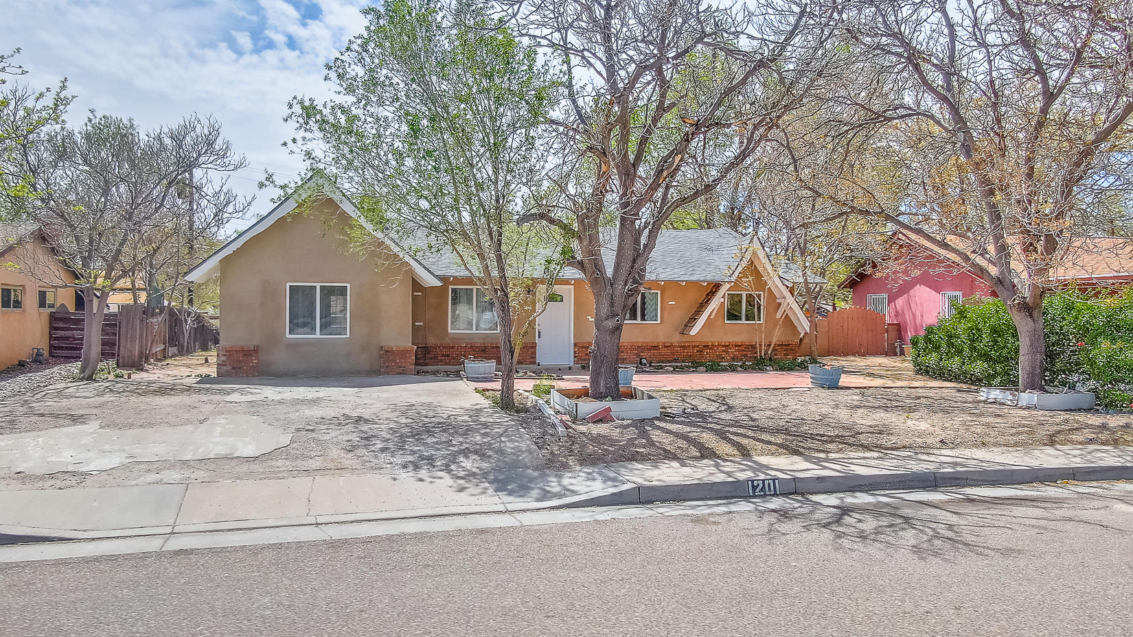 This house is cute as a button!  Charming property on .21 acres has a fantastic flowing floorplan with a family room and cozy living room with wood burning fireplace. The bright kitchen has crisp white cabinetry, tile backsplash and stainless gas stove. New laminate in family and living rooms! The large backyard has a covered patio and is the perfect canvas to turn into your dream yard. Convenient location has easy freeway access. This home is absolutely perfect - book your tour today!