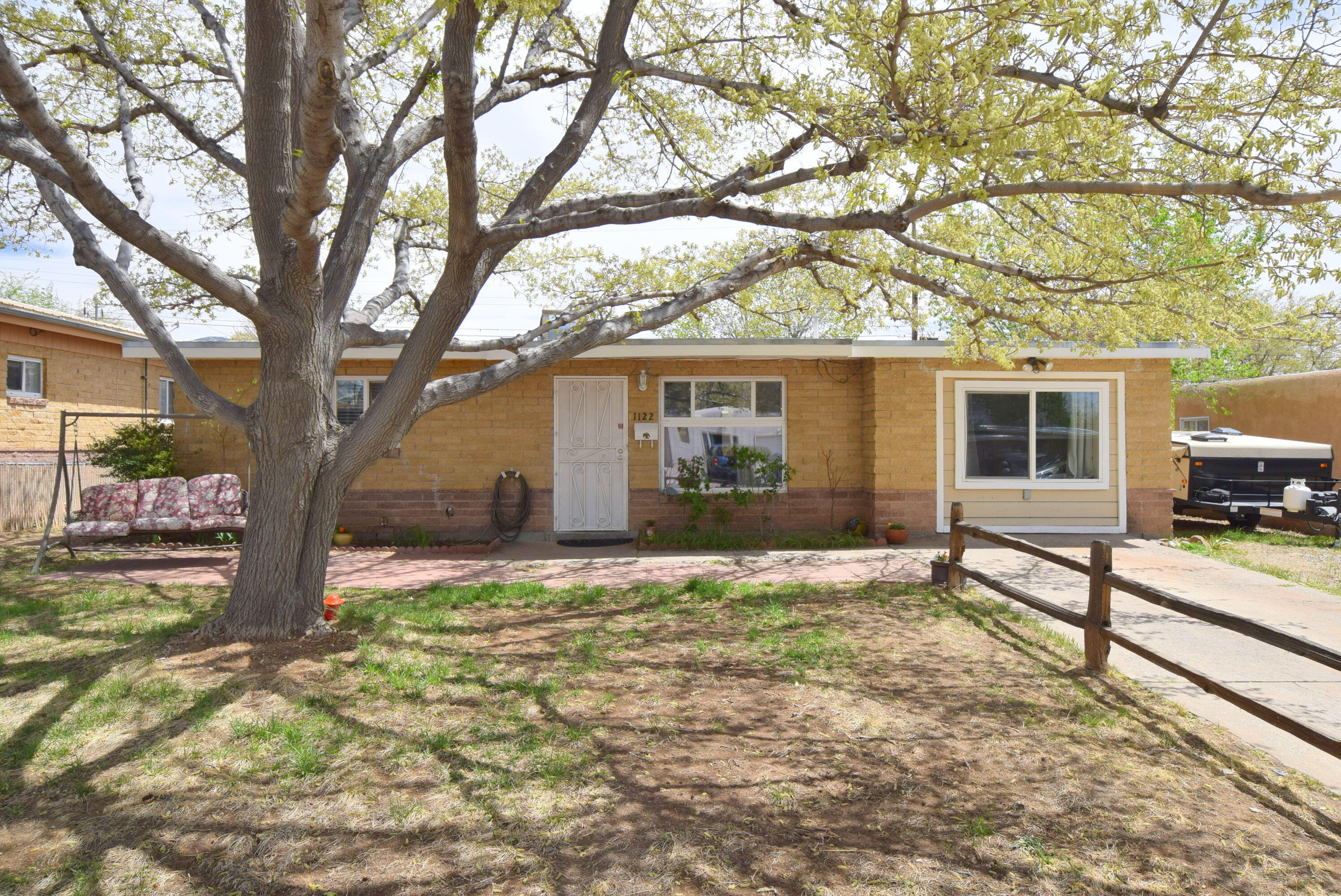 Come and see this cute house in the northeast heights.  Home has been well cared for and is ready for a new owner! 2 bedrooms with a possible 3rd or another living area.  Great walled backyard with plenty of storage.  Oversized utility room with washer and dryers to stay.  Great curb appeal.  This home will not disappoint!