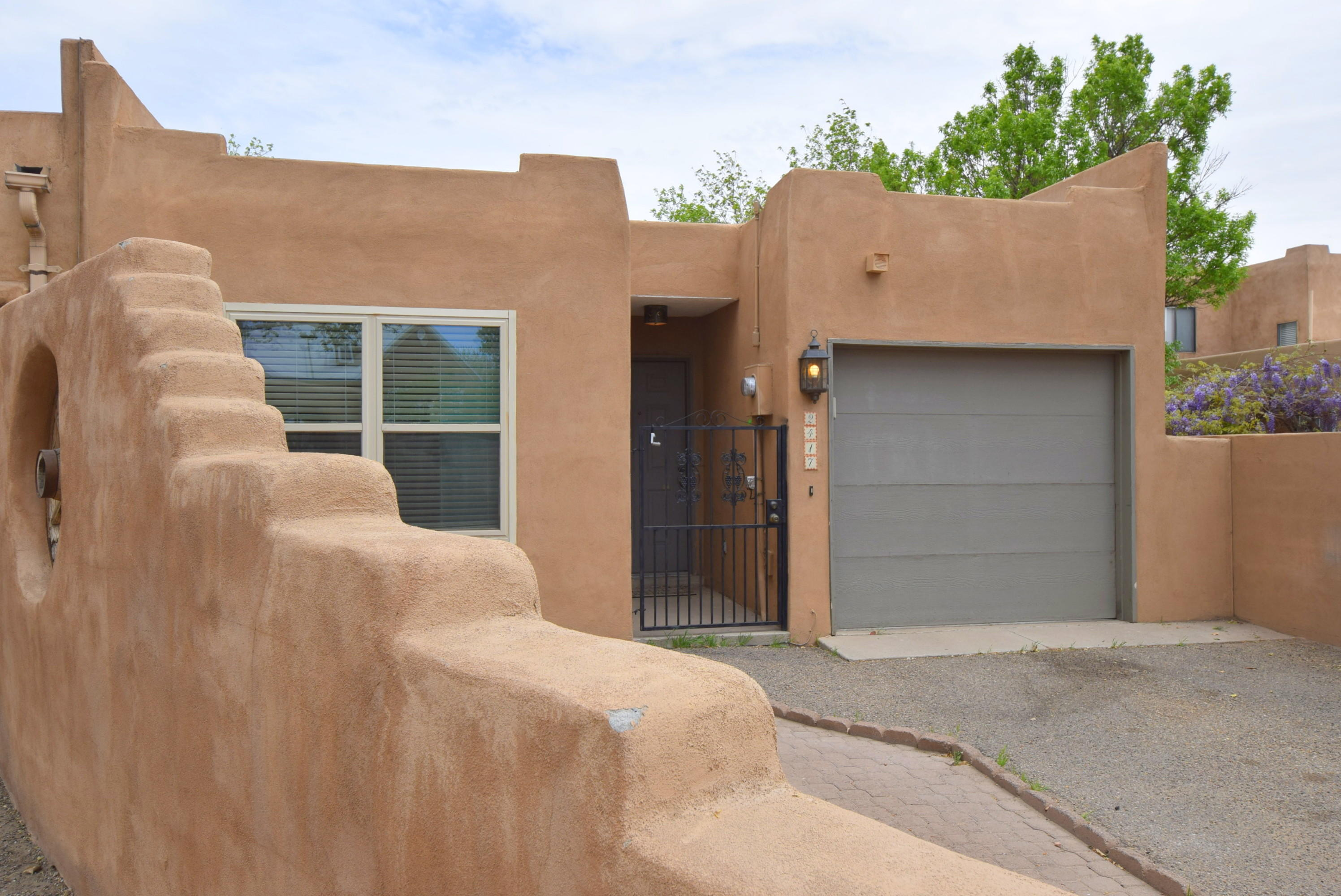 Fully renovated.  Saltillo tile throughout.  Kitchen with granite and stainless steel appliances.  GREAT location.  Super close to Old Town.  Unique copper lighting throughout.  Perfect Southwestern flair.  Private patio.  One car garage with additional parking.
