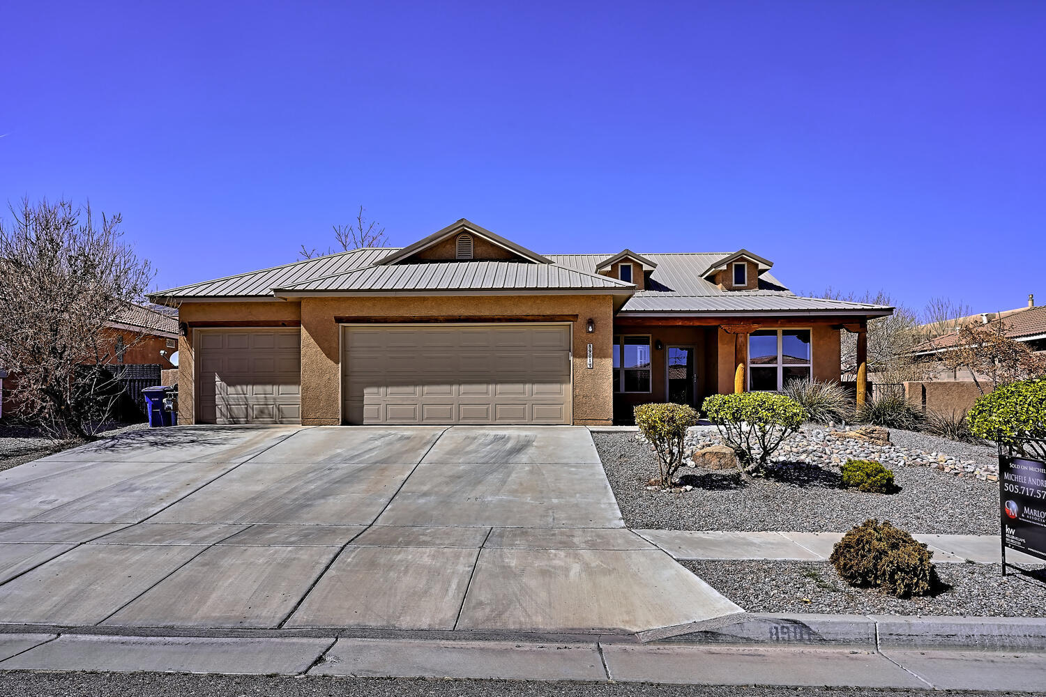 Stunning single story upgraded Northern New Mexico style home with metal roof, 4br or 3br plus office, 2ba, 3 car garage in prestigious Petroglyphs subdivision. Location, location! Kitchen features granite countertops, stainless steel appliances bar, bk. nook, spacious pantry. Huge MB with Separate jetted tub, double sinks, spacious walk in closet. Sep. formal dining. Great room features a ceiling fan and wood burning FP with a gas starter. Newer water heater, High ceilings, light and bright. Private, nice sized backyard with covered patio for BBQ's, private and walled with a large dog run on side yard. Mins. to the trails at Petroglyph National Monument. Close to shopping and the freeway, easy access. PRICED TO SELL, show this beautiful home today!!