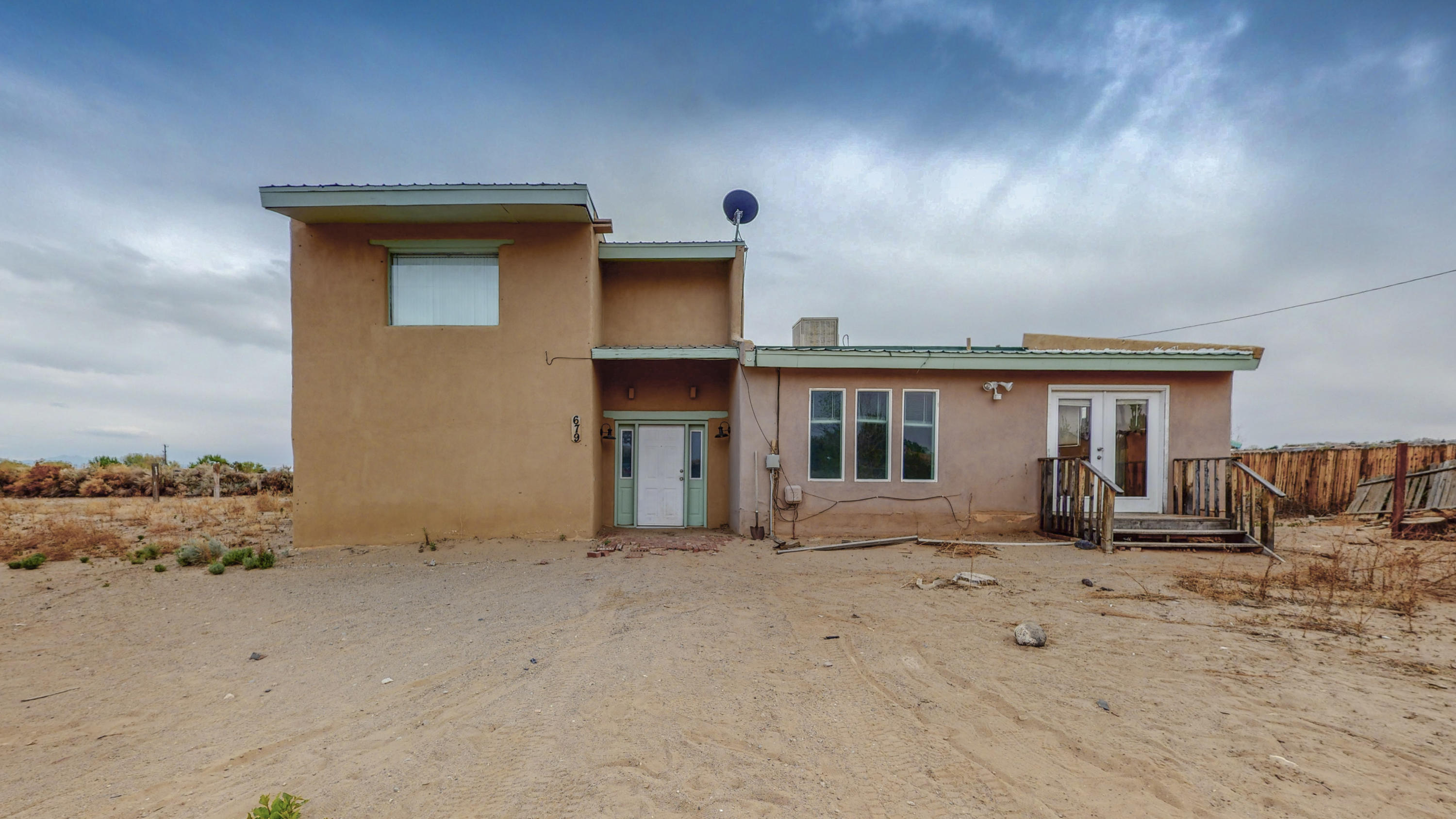 SOLD AS IS part of an estate, home is located on a very private Corrales road with a full acre of horse property. 3 bedrooms and 2 baths with an open floor plan, multiple levels provide great views from most bedrooms. Stucco needs some TLC but most of home is in great shape.