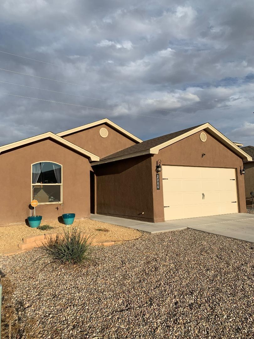 Beautiful Custom home in desired location in the Heart of Los Lunas! This immaculate home features gorgeous views of the mountains from both front and back of this home!, Modern colors, Custom tile flooring, custom back splash, Separate Tub & Shower, 2 sinks in master bath, 2 Walk in closets in Master bedroom, Pantry for storage, Finished garage with remotes, Refrigerated Air Conditioner, Front & Back landscaped, Ready for IMMEDIATE Move in!, Located next to Movie Theatre, Shopping, Restaurants, Easy Access to I-25. Must See!