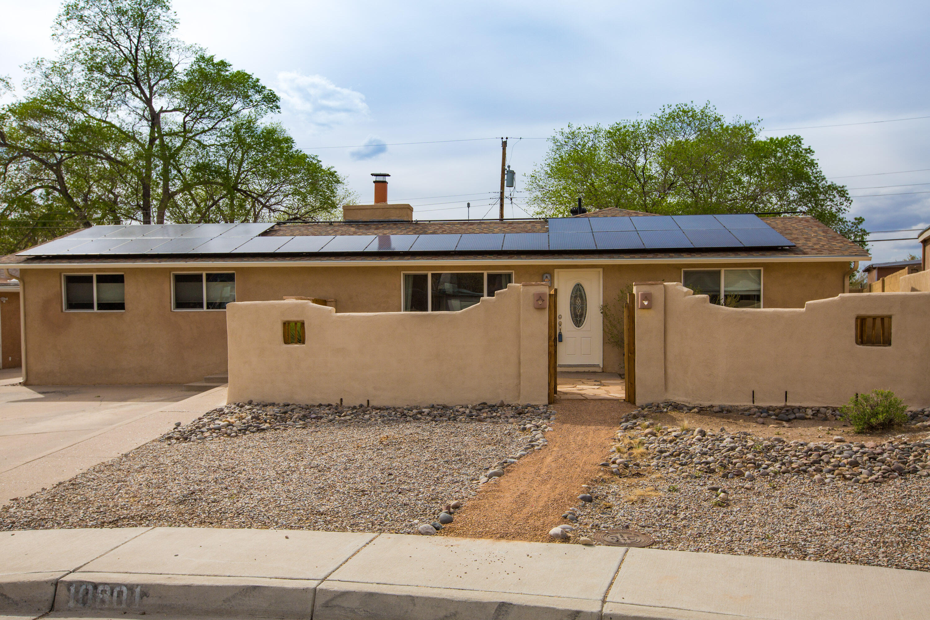 Fully owned solar makes living in this spacious versatile home affordable and easy. Lots of updates and features include welcoming front courtyard, view of the mountains, lots of natural light in the living areas and privacy and quiet in the four bedrooms. Updated kitchen, well-equipped walk-in closet in the huge owner's suite goes well with the large bathroom featuring garden tub and shower. Outside features lush grass and plantings, a covered pergola for shade and privacy and more.
