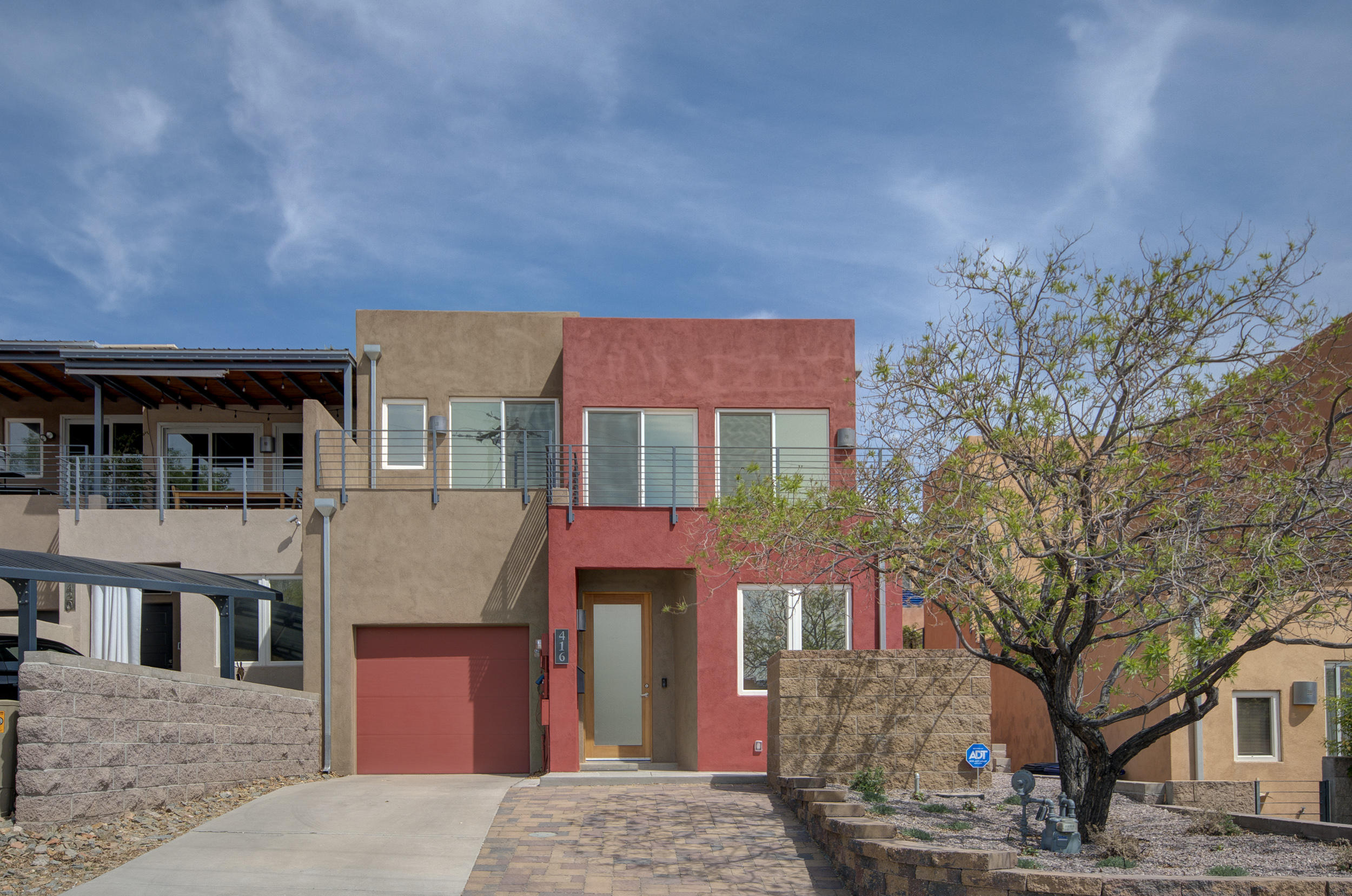 Spruce Park Townhome.  Excellent Location Close to Hospitals, UNM And Downtown   Three Large and Separate Bedrooms with Three Full Luxurious Baths!  Awesome Reverse Floor Plan with Owners Suite, Living Room, Dining Room and Kitchen Upstairs.   Finished/Oversized Tandem Garage with Room for a Workshop and Access to Back Yard. End Unit Features 3 Balconies, A Covered Patio and Low/No Maintenance Yards. Bamboo Hardwood Floors on Upper Level, Stained Concrete on Lower Level. Newer LOW E and Tinted Thermal Patio Doors Plus Energy Efficient Windows, Radiant Heat and 5 Yr. TPO Roof. Owned SOLAR PANELS Provide a Huge Savings.   You'll Love Panoramic Views of The City and Twinkling Night Lights. Newer Stainless Kitchen Appliances. Washer and Dryer Stay Too!  Walk Score of 72, Bike Score of 83.