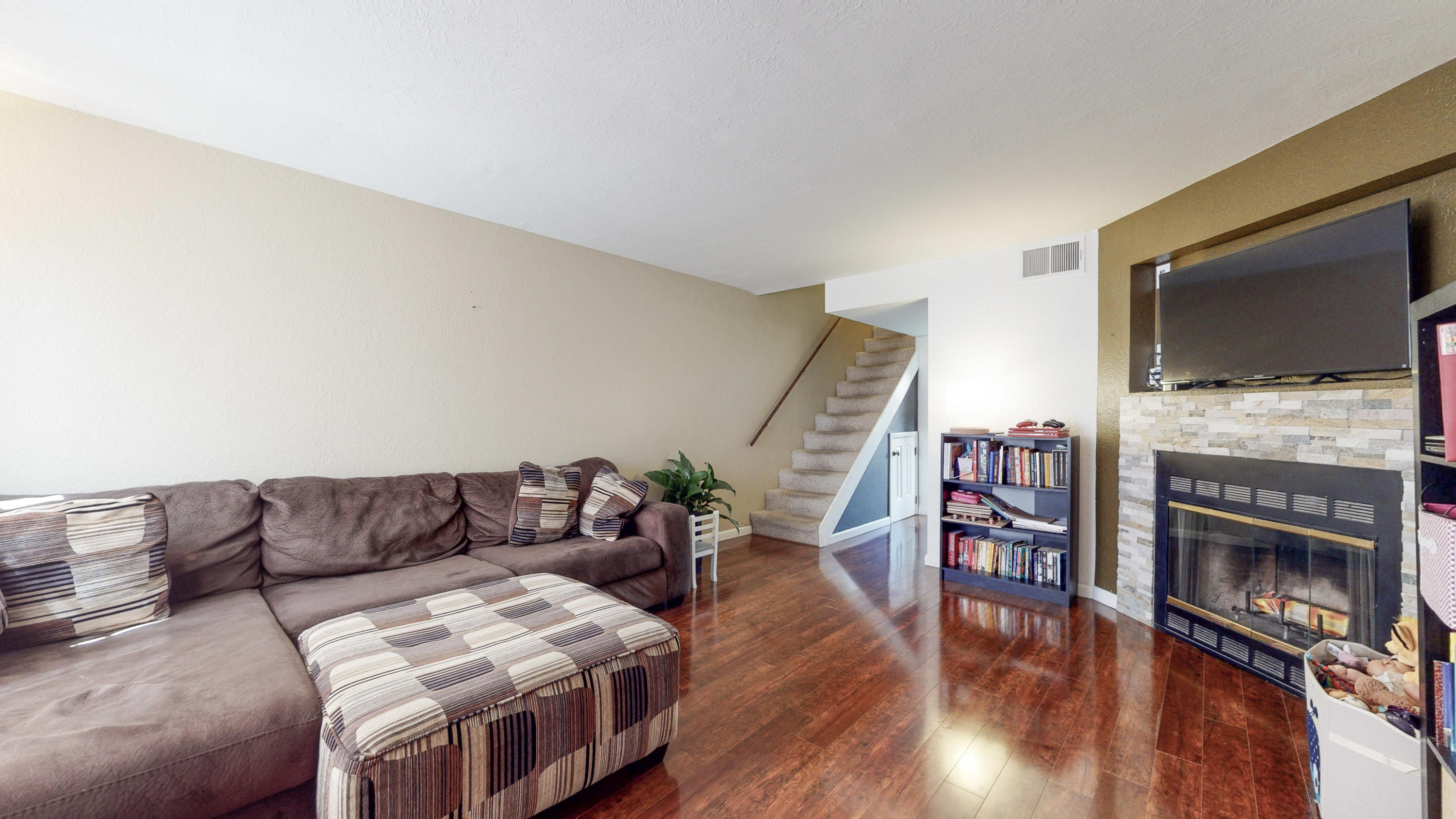 Beautifully upgraded 2 bedroom condo! Centrally located, well-maintained complex.  Fireplace in the living room with laminate floors throughout. 2 master bedrooms with an additional bathroom downstairs. Great little backyard courtyard for relaxing on beautiful summer nights! Come by and view your next home today!