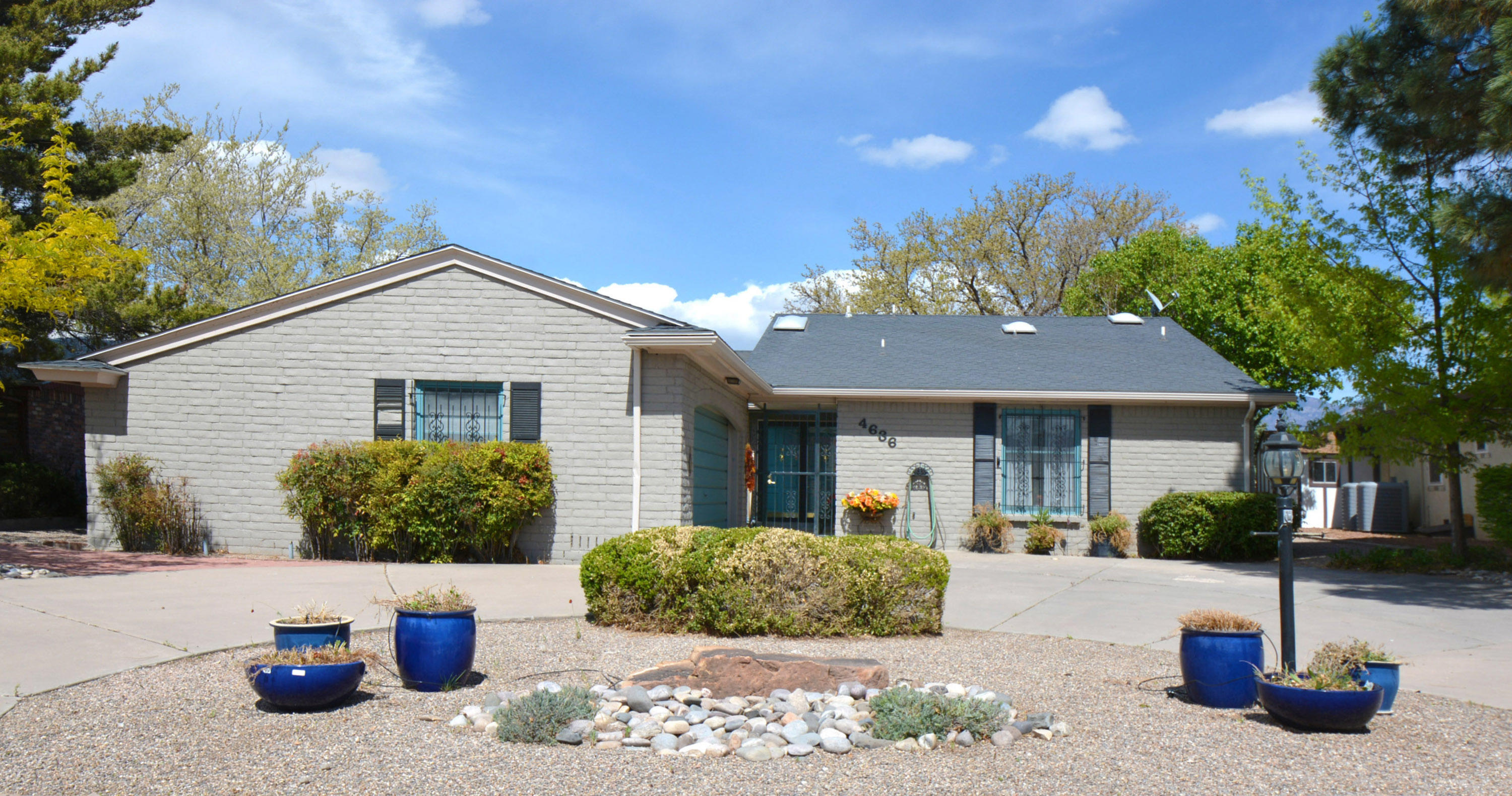 Lovely Updated home on large lot with Fabulous mountain views. 3 bedrooms plus an office. Many updates include new CFA Heat and Refrigerated Air unit 2020, kitchen remodel in 2018, hall bath remodel in 2020 and master bath remodel 2012. New stucco 2018. New roof 2010.  Extra blown in insulation in ceilings. 3 sky lights. Walk-in closets in 2 bedrooms plus large bonus hall closet. Security bars with bedroom releases. Large finished garage, Circular driveway. Designer landscaping with brick lined walk-ways. Large covered back patio that is perfect for entertaining and appreciating the million dollar views of both the mountains and the Arroyo del Oso Golf Course.  Backyard vehicle access. This home has been lovingly maintained and is move in ready.