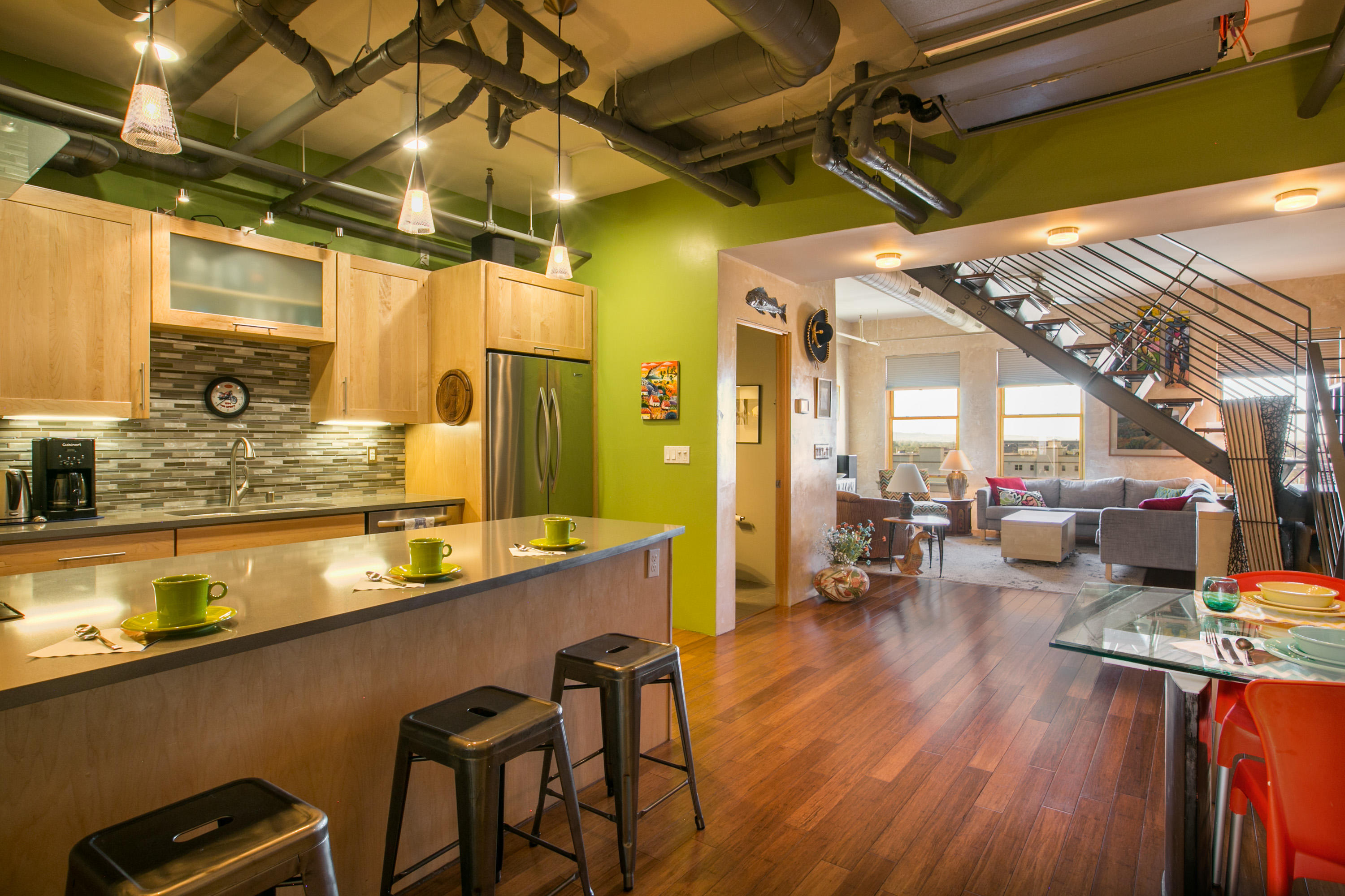 Located in the Heart of Downtown ABQ in the secure key card access old Sunrise Bank building.  This 2 level unit is beautifully appointed with modern fixtures, lighting and materials.  The kitchen features stainless steel appliances and custom cabinetry.  A half bath is located on the first floor.  Follow the steel and wood staircase to the 2nd floor where you'll find a master bedroom suite with a private patio, walk-in closet and spa style bath.  The large guestroom has beautiful south facing views.  Access to the 8.000+sqft rooftop deck with expansive panoramic views of the city and mountains!  5th floor garage access parking is optional.