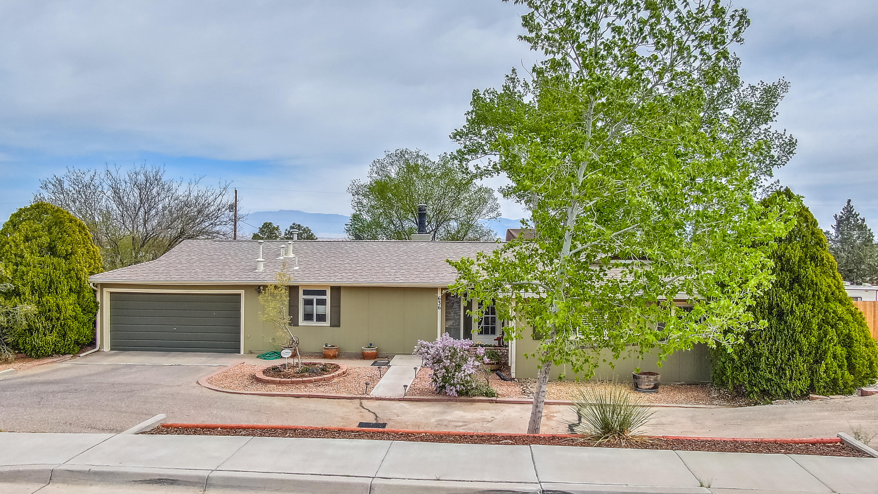 Showings Start Thursday May 6!Beautifully remodeled one story ranch style home on just over 1/2 acre landscaped.  Move in ready. Remodeled open plan kitchen with wine cooler, coffee bar, & pot filler faucet with newer flooring-tile, hardwood and pergo. Remodeled master bathroom 2019 with tub and separate shower. Backyard is great for entertaining with a custom built wood fire pizza oven, gazebo, firepit and large patio.  Oversized family room.  Huge laundry room with lots of storage space. Area on side of home large enough to park RV and boat. Roof and gutter new in 2014, furnace 2017 and Cooler 2015.  Easy access to the freeway, shopping and restaurants. Don't miss this Wonderful Home!