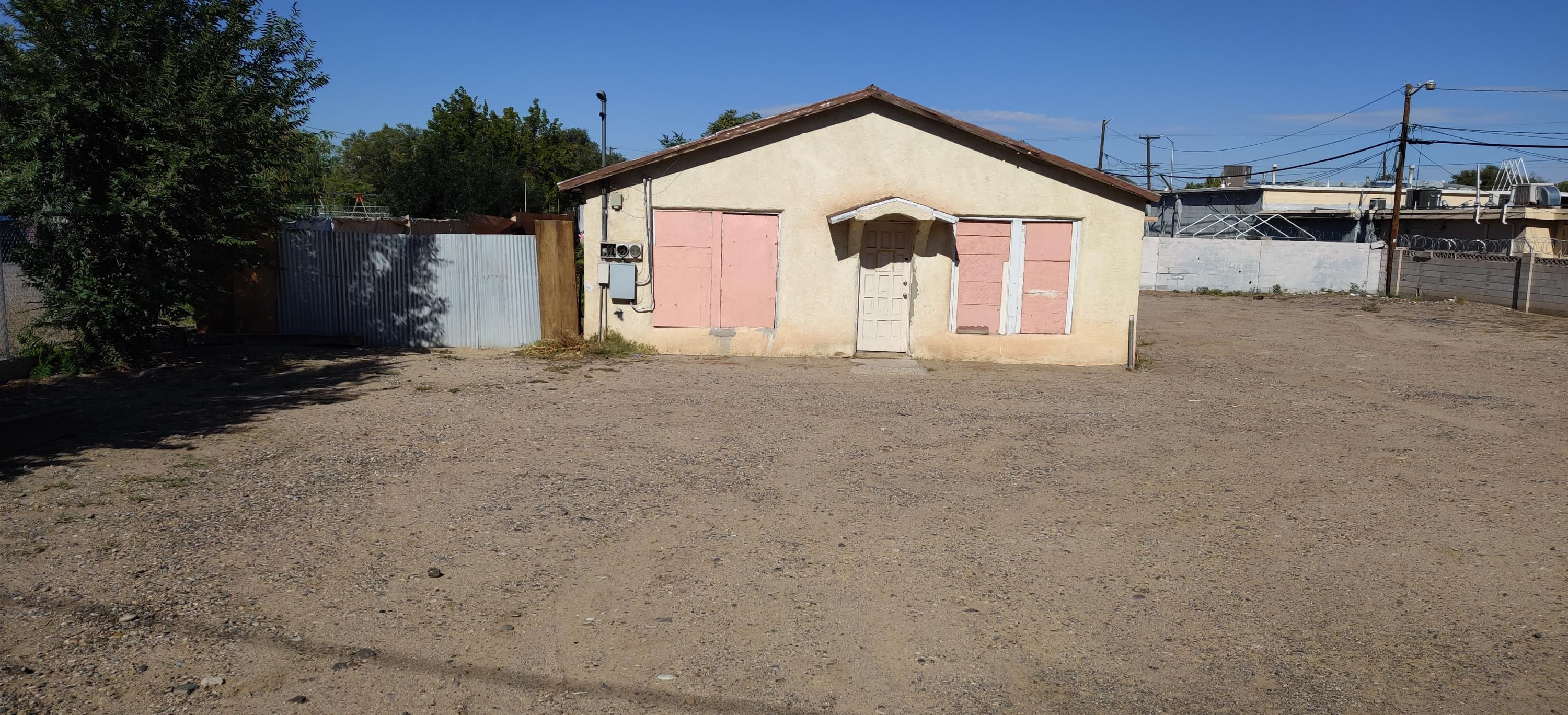 Location is great but home does need repairs. Zoning allows for residential or commercial use.  Guest house/Casita in the back is 1 BR 1 BA, 416 sqft. Seller will consider owner-financing! The lot 151 Isleta can be sold together.