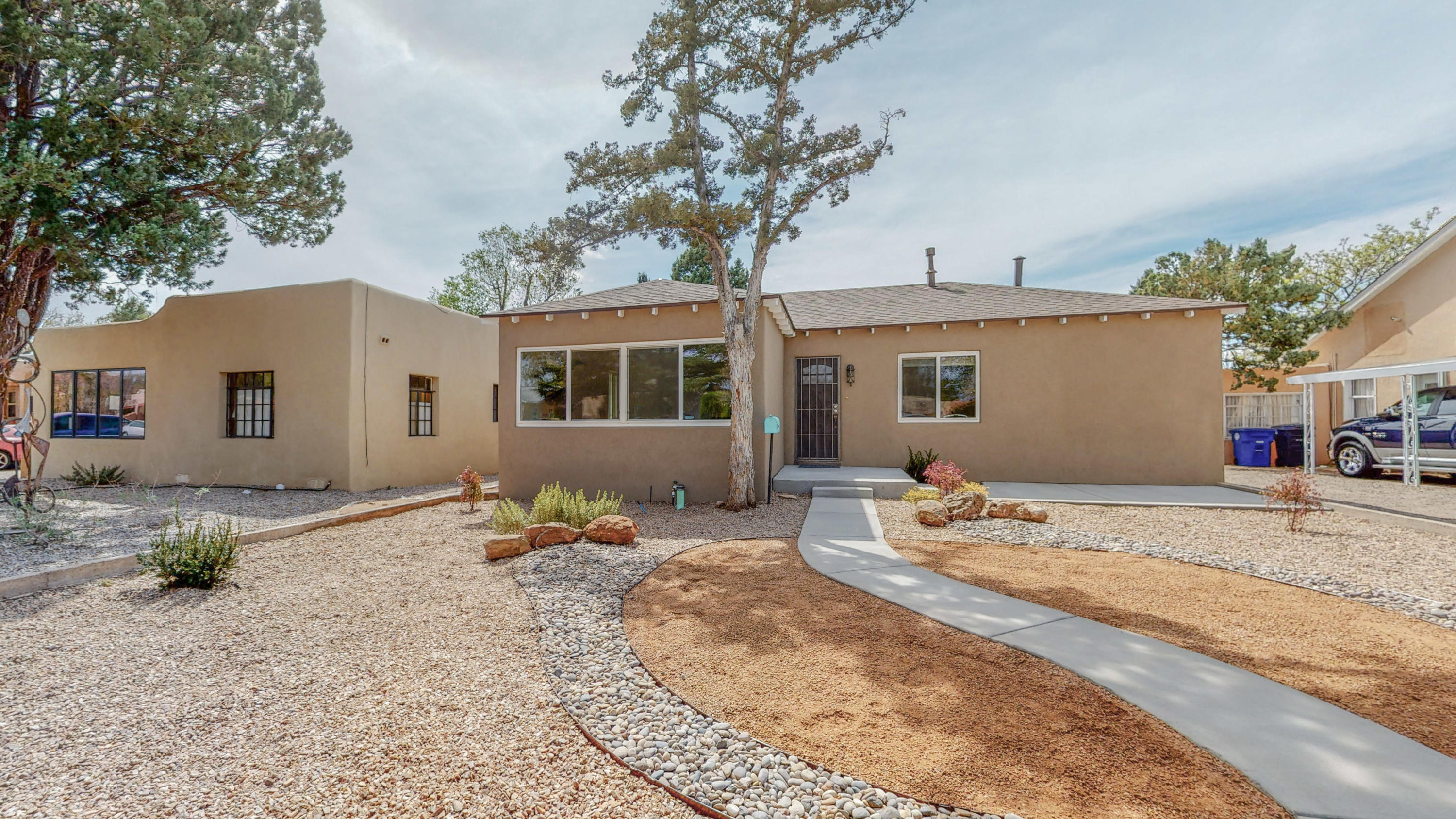 Gorgeous completely remodeled UNM Bungalow.  Walk through the door and walk back in time! Gleaming Hardwood floors, coved ceilings, built-in cabinetry. Charming Kitchen with stainless appliances, new quartz countertops, farmhouse sink and new fixtures, Roof replaced 2/2020, New H2O heater, new furnace and refrigerated air, new stucco, new windows, new front exterior door, original interior doors stripped to show their beauty and original hard ware, sliding repurposed barn doors, new bathrooms, freshly landscaped.  All you have to do is unpack.