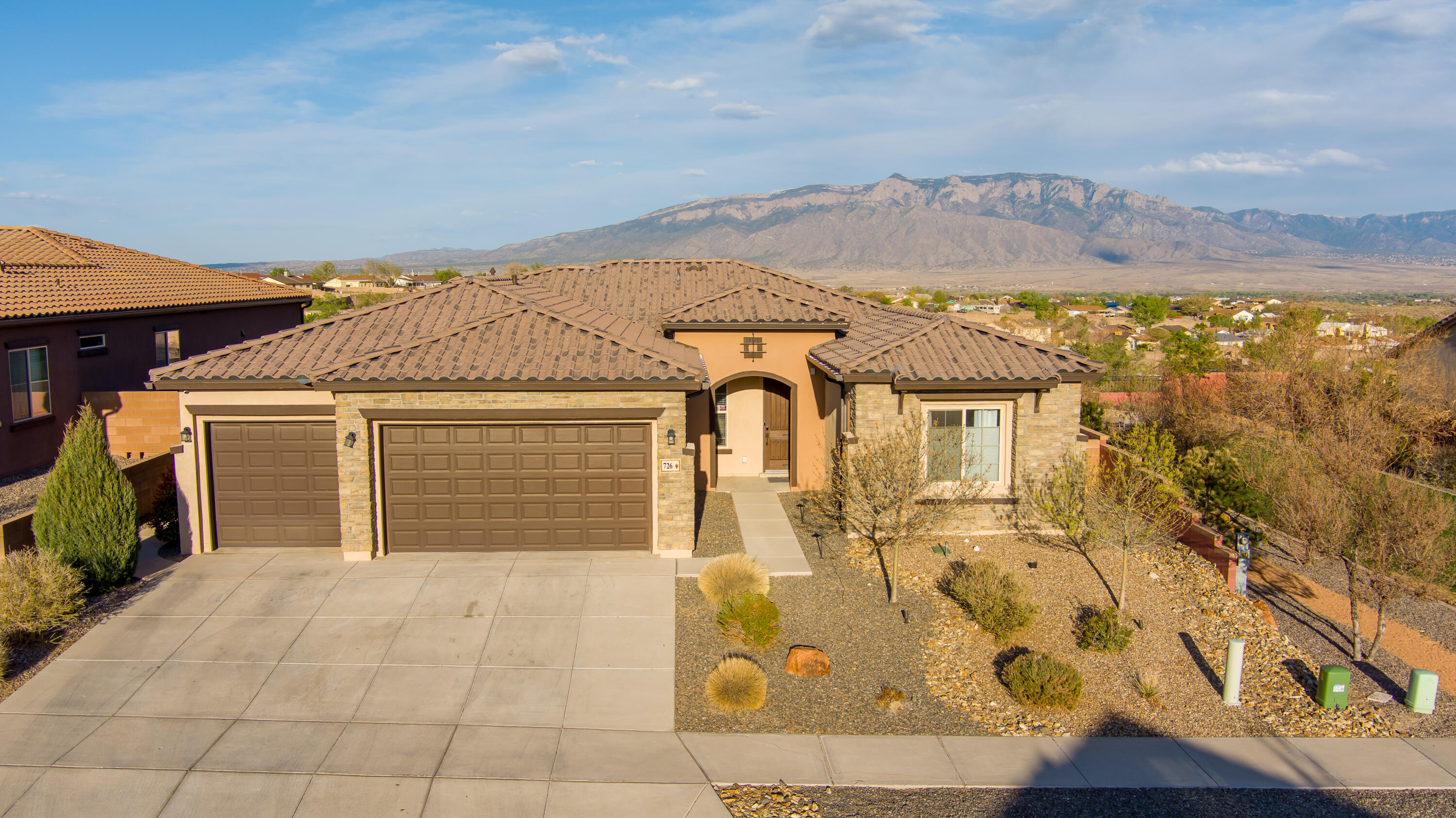 Stunning home in the beautiful community of Loma Colorado/Tres Colinas!  This 3/4 bedroom home has an abundance of natural light and breathtaking unobstructed views of the Sandia's and Albuquerque.  This open floor plan offers a beautifully upgraded kitchen with tons of cabinets, large island w/ bar seating, upgraded fridge and SS appliances. The master suite captures the gorgeous views of the Sandia's, a large walk-in closet that has been customized, and a spa-like bathroom with a large walk-in shower. There is plenty of storage space in this home and the 3 car garage makes storing your extra toys easy!  The backyard boosts an outdoor built in grill and counter top as well as a beautiful covered patio with fireplace!   Come and see this beauty before it is gone!