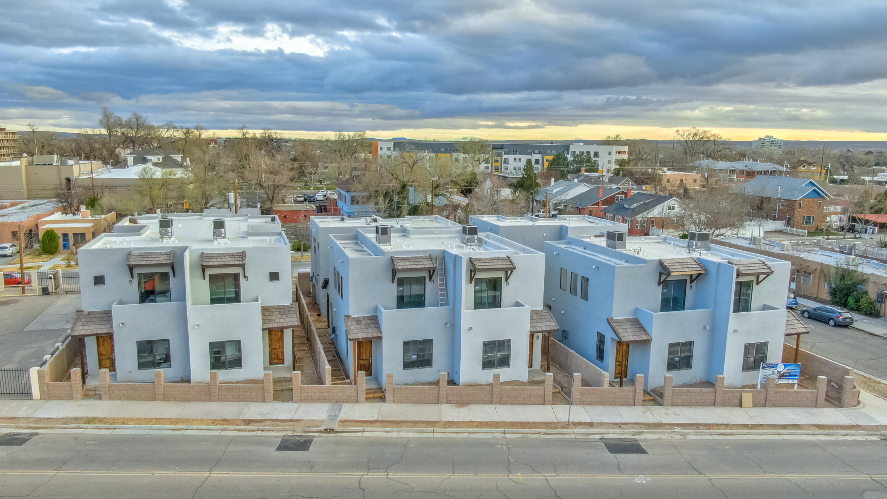 Ibiza Townhomes! Brand New Custom Built Two Story Townhomes, located in the trendy downtown ABQ! Location, Location, Location! These amazing homes are built with custom flooring, tall ceilings, full overlay cabinetry and granite counter tops. The 4 bedroom design includes 4 full bathroom, plus a 1/2 bath for guests. Featuring a detached garage with full studio above with kitchen, bathroom and laundry area! Custom touches in every bathroom like tub to ceiling 3-D style tile, furniture style vanities and tankless water heaters, plus AC combo units for you hot and cold needs. Enjoy the large finished double car garage with plenty of parking on the oversized drive pad.