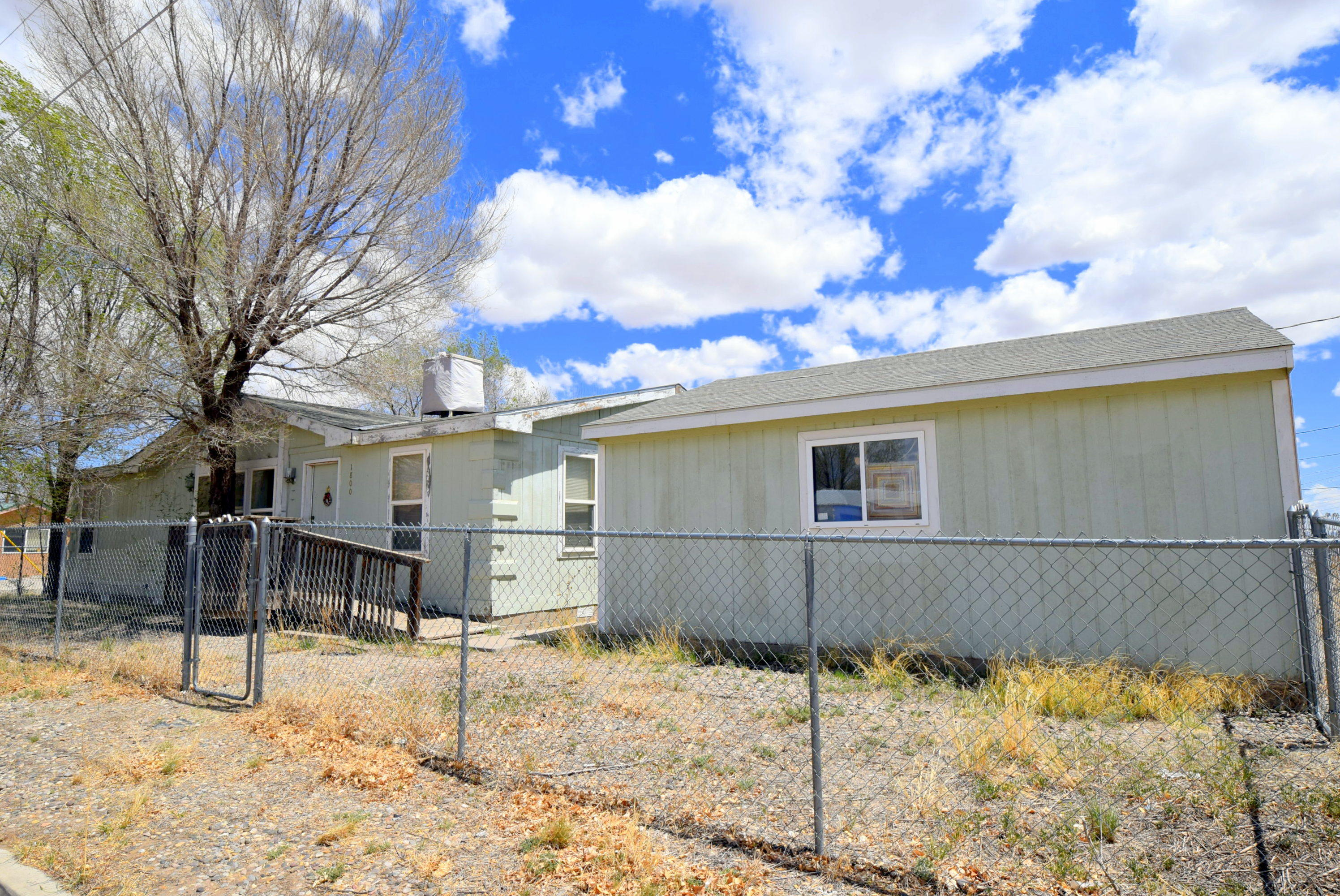 Small town living a short commute from town! Fully fenced yard and a 2 car garage. Alley and back yard access.