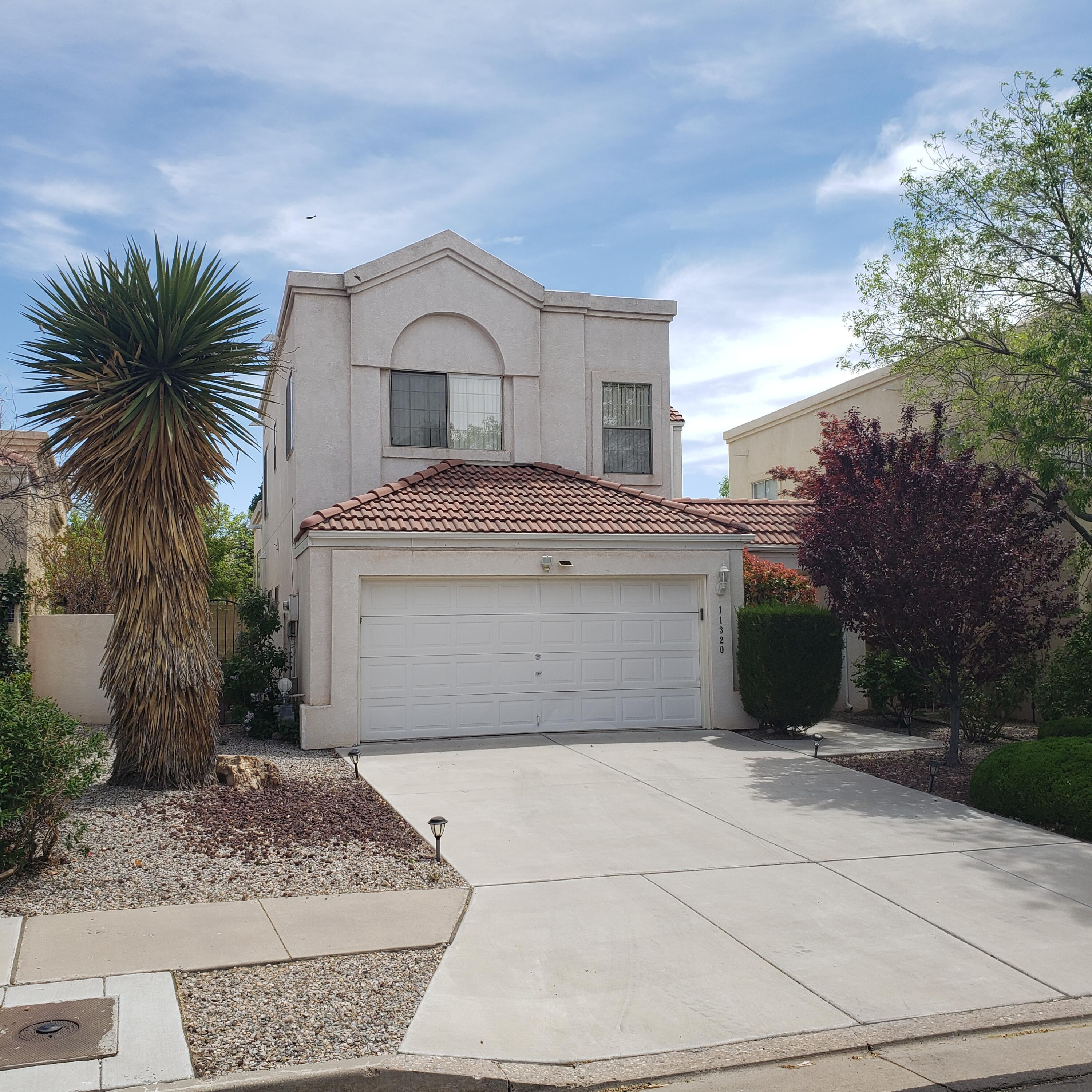 This well-kept 2-story home is in a great location!    It has friendly, indoor / outdoor living with privacy.  There are  3 bedrooms, 2.5 baths, 2 living areas, and an office.  Mountain views of the Sandias from the bedrooms upstairs are good. The family room is well-lit with natural light from the bank of south-facing windows.  The floorplan has a good combination of community space and privacy thanks to the open kitchen-greatroom, multiple living rooms, and separate office.