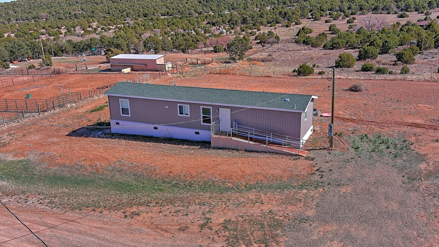 Super nice 4 year old Karsten home! Nice kitchen, complete with stylist dark cabinetry open concept great floor plan! master separate from other bedroom! Still like brand-new! Gorgeous laminate wood like flooring throughout, nice quite dead end location!, Beautiful setting, lots of trees and gorgeous views! fully fenced in! exterior sheds, Handicap access, pull bar, exterior front door ramp, and so much more!