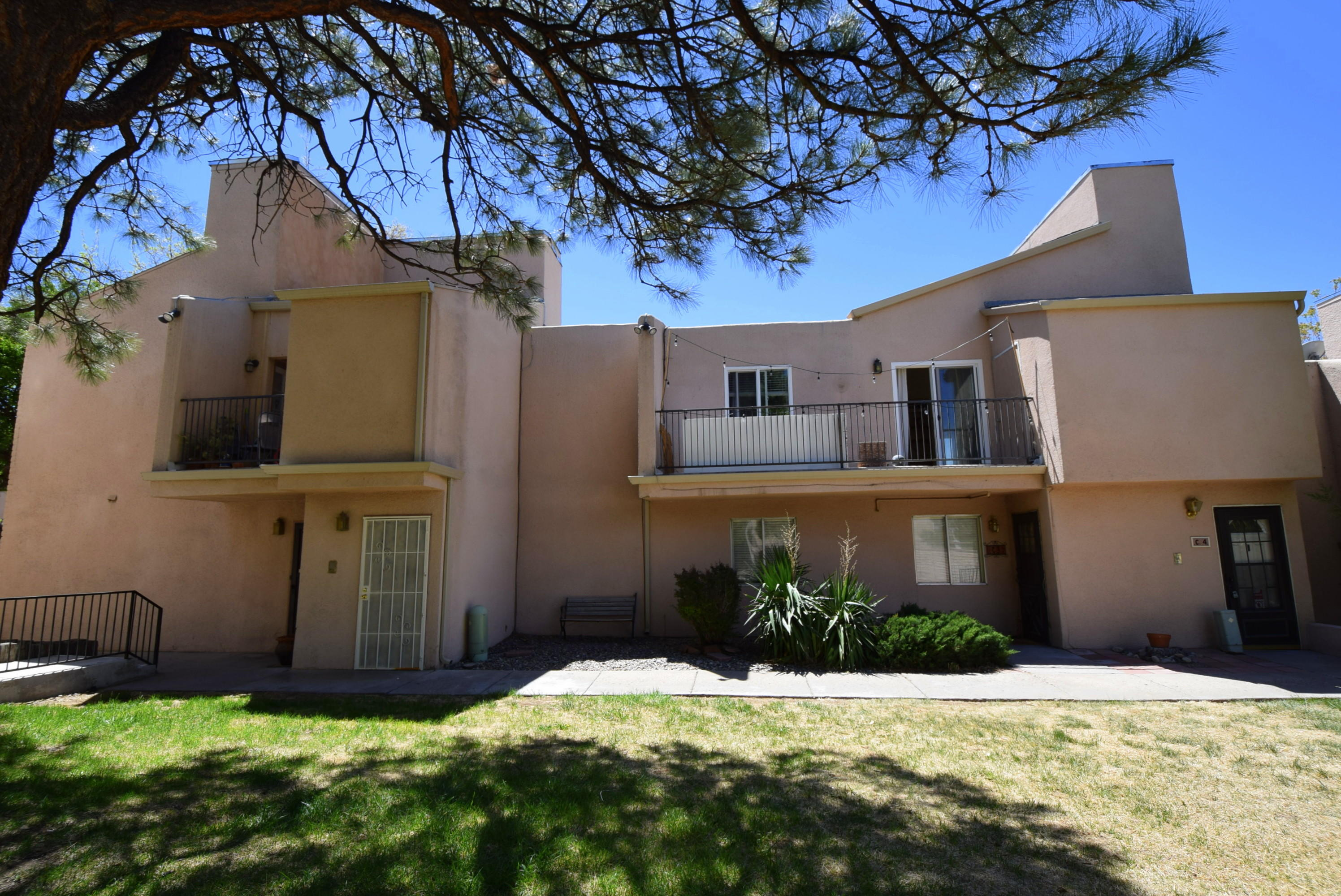 Ground floor unit with numerous updates! New carpet and new interior paint. Located across from the pool. Enclosed rear patio/yard. HOA fee incudes water, trash, exterior maintenance, water heater, pool and grounds.