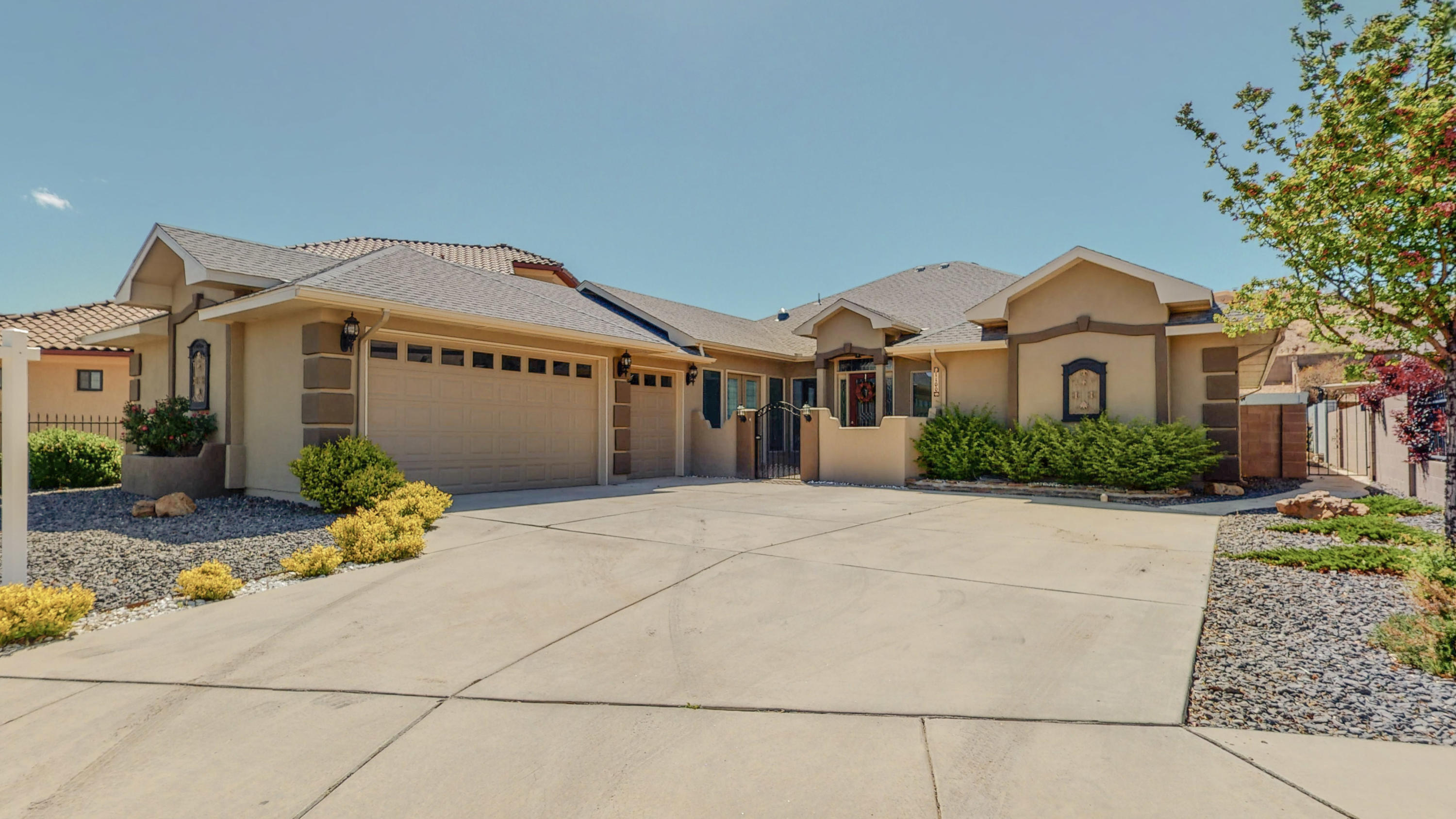 Custom home located in a highly desirable neighborhood in the heart of Los Lunas. You will love the high ceilings, open floor plan, and gourmet kitchen fit for a chef, perfect for entertaining with stainless steel appliances, commercial refrigerator, double ovens, and large kitchen island. This home has two wonderful master suites on a split floor plan boasting beautiful en suite bathrooms, and grand walk-in closets. Additionally, this home offers a landscaped backyard, 3 car garage, duel refrigerated air units, and much more! See more photos and virtual tour