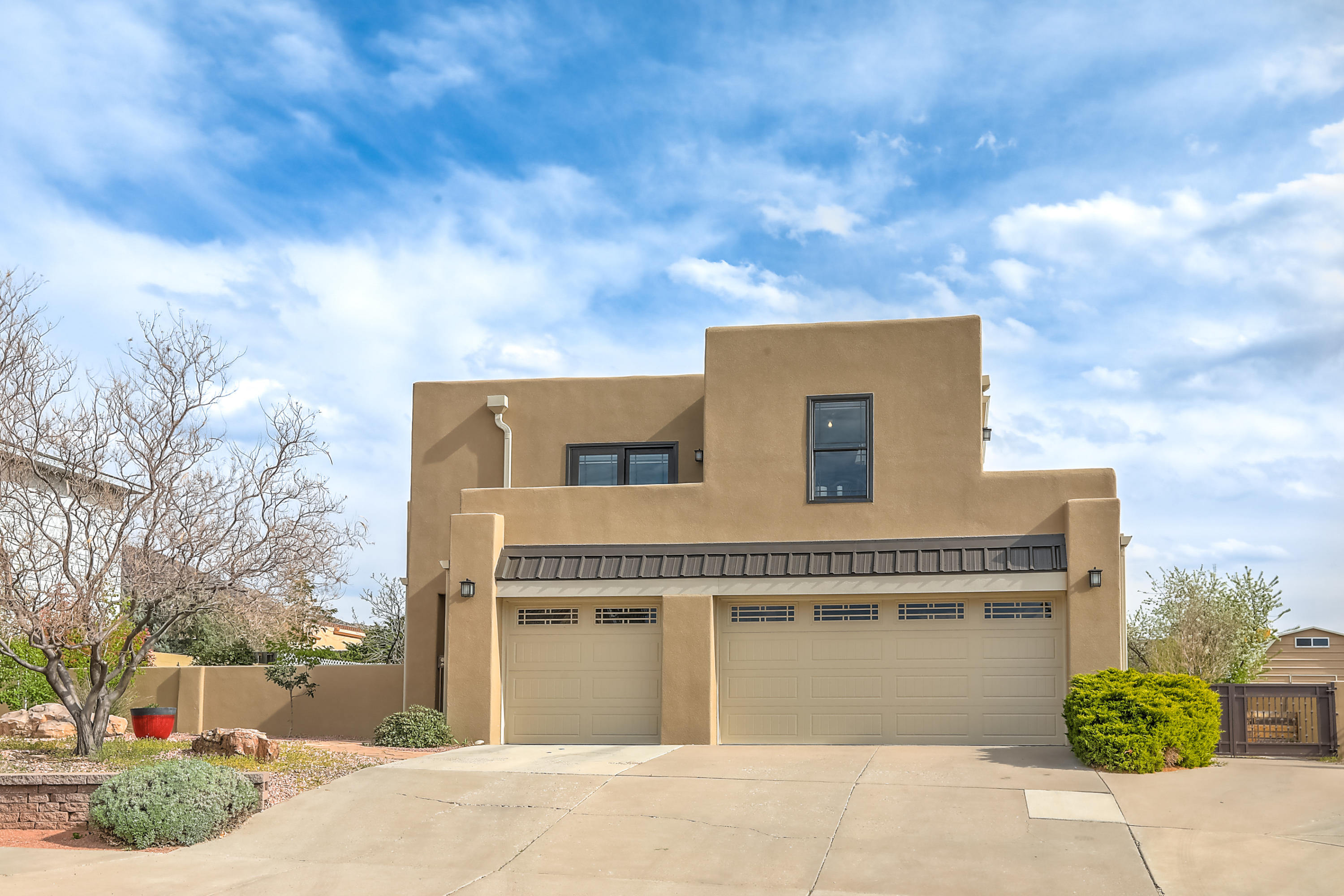 Meticulously updated throughout with top quality finishes. Upgrades include Pella windows & doors, tpo membrane roof, stucco and much more. Hard to find 3 car garage plus backyard access with room for RV parking. Front courtyard, two covered patios on the south and west sides of the home and balconies to enjoy the Sandia and mesa views. Soaring ceilings greet you in the living area which is complete with built-in bookshelves and a cozy fireplace. Refrigerated A/C. Kitchen boasts ample cabinets for storage and is open to the dining area perfect for entertaining. The master suite is spacious & features a luxurious bathroom with double vanity &large shower with frameless glass. This home will not disappoint & all in a superb location.Easy access to dining, entertainment, parks & much more!