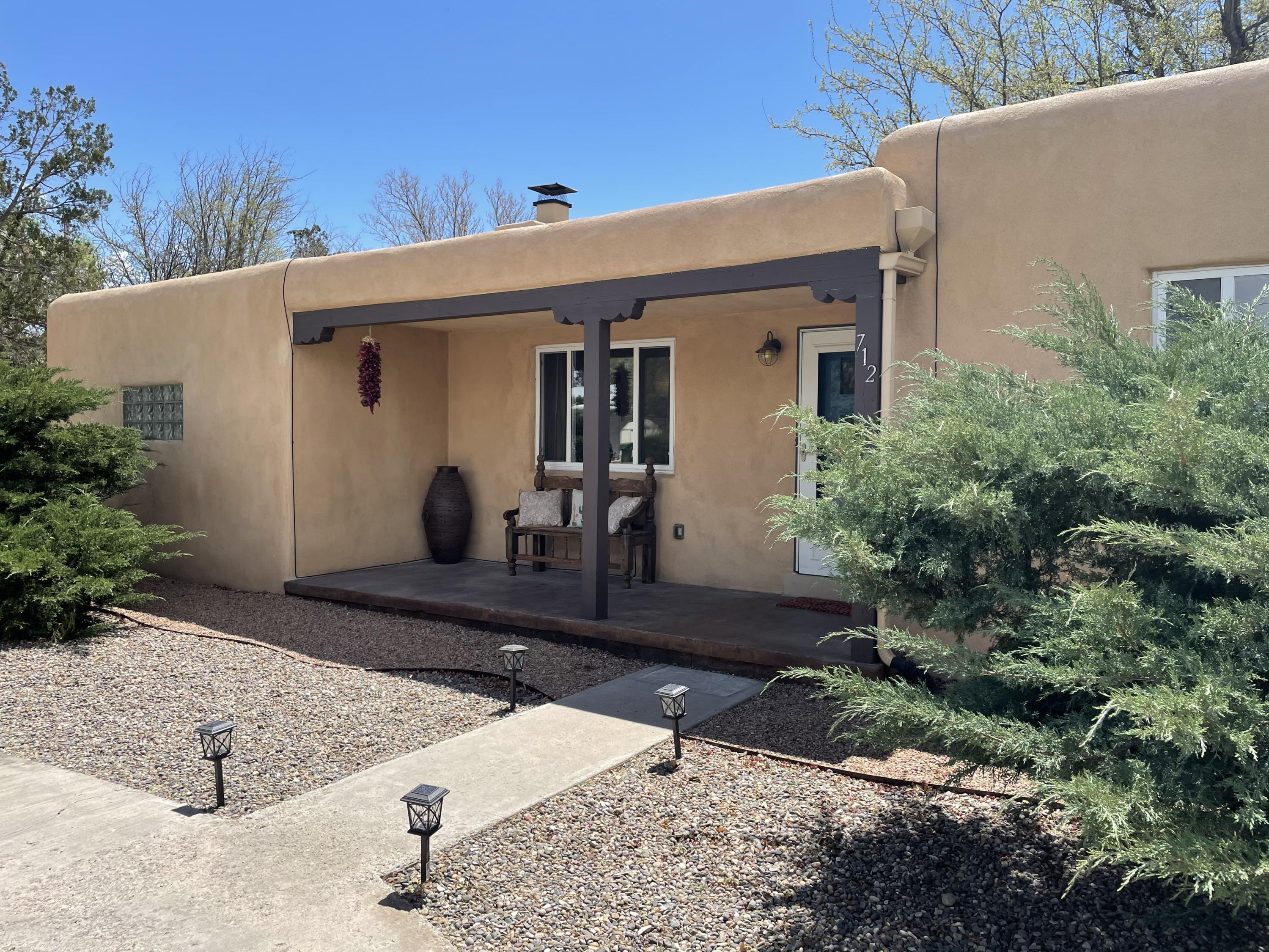 An incredible opportunity to buy in coveted los Ranchos De Albuquerque! Situated on 1/2 an acre made up of two lots, this little casa is the epitome of charming. So very clean! The hardwood floors are freshly redone and they look AMAZING! The natural light in this house is fantastic! Way too many updates to mention here but highlights include all appliances, counter tops, lighting, flooring, windows and on and on. The possibilities with this lot are endless; a massive garden, animals, a pool and big addition...or live in the front while you build your dream house in the back! Supremely located a stones throw from the 4th street retail corridor, the acequias, Bike trails public transport and every conceivable service an amenity. Please see showing instructions! Request a private showing today