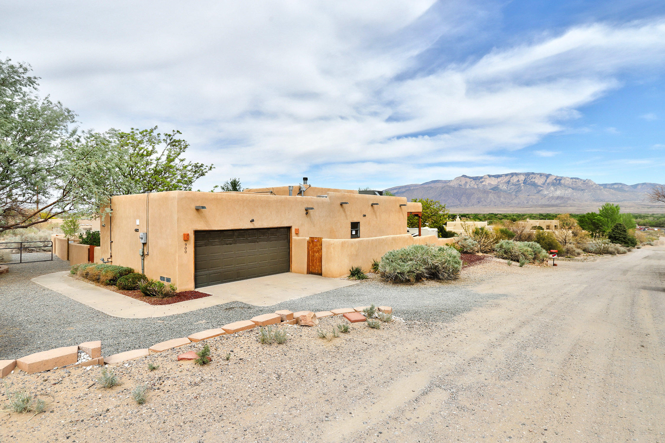 Southwest style home with Sandia mountain views . Stainless steel appliances. Granite countertops.  Viga ceilings, Saltillo tile. Low maintenance yard.  New Paint, New Carpet, New fixtures.
