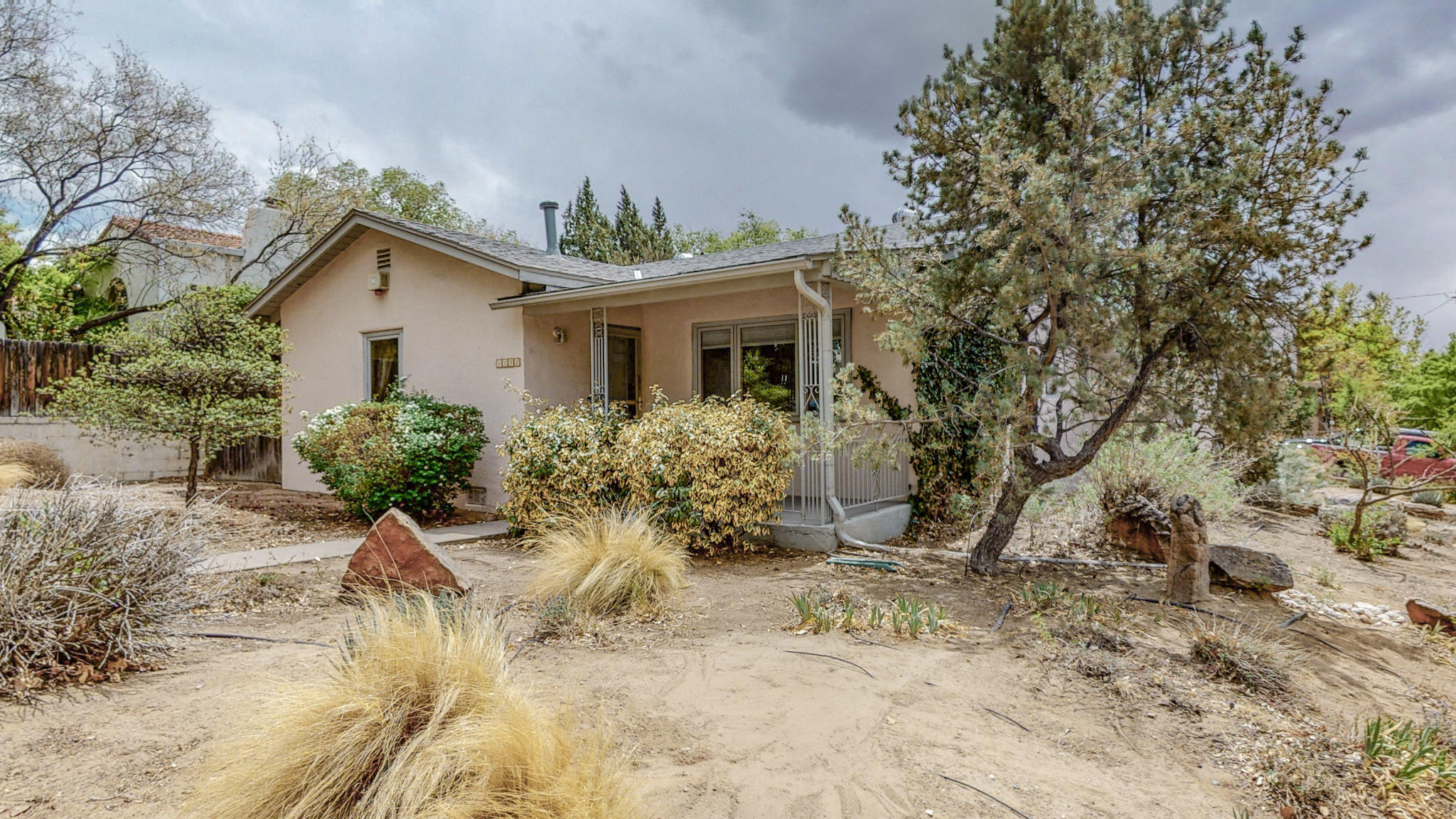 Great Home in Sensational Spruce Park! Hardwood Floors, Pella Windows, 3 Bedrooms, 2 Full Baths, Kitchen open to Dining Room with bar. Refrigerator and Washer/Dryer are included. Oversized 2 Car  Gargage includes workshop area. Close to UNM.