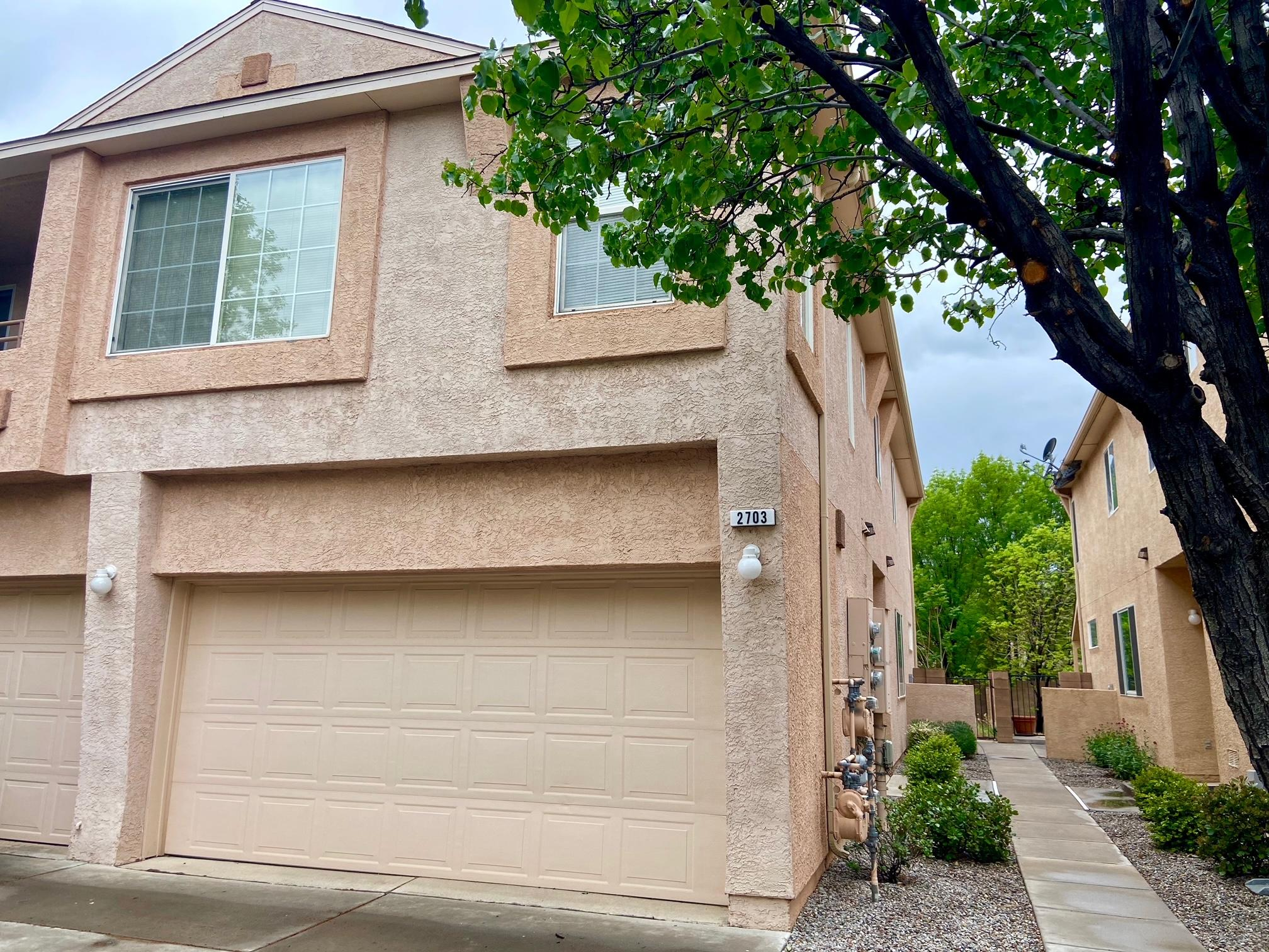 Gated community in convenient NE Heights location. 2 car garage! Such a great floor plan. Living room with fireplace is on the main floor. Bright cheerful kitchen, island, breakfast nook and patio door leading to nice small yard. 2 bedrooms with loft upstairs. Beautiful community pool. HOA Covers Exterior of residence (roof and stucco), common area, pool, and gate