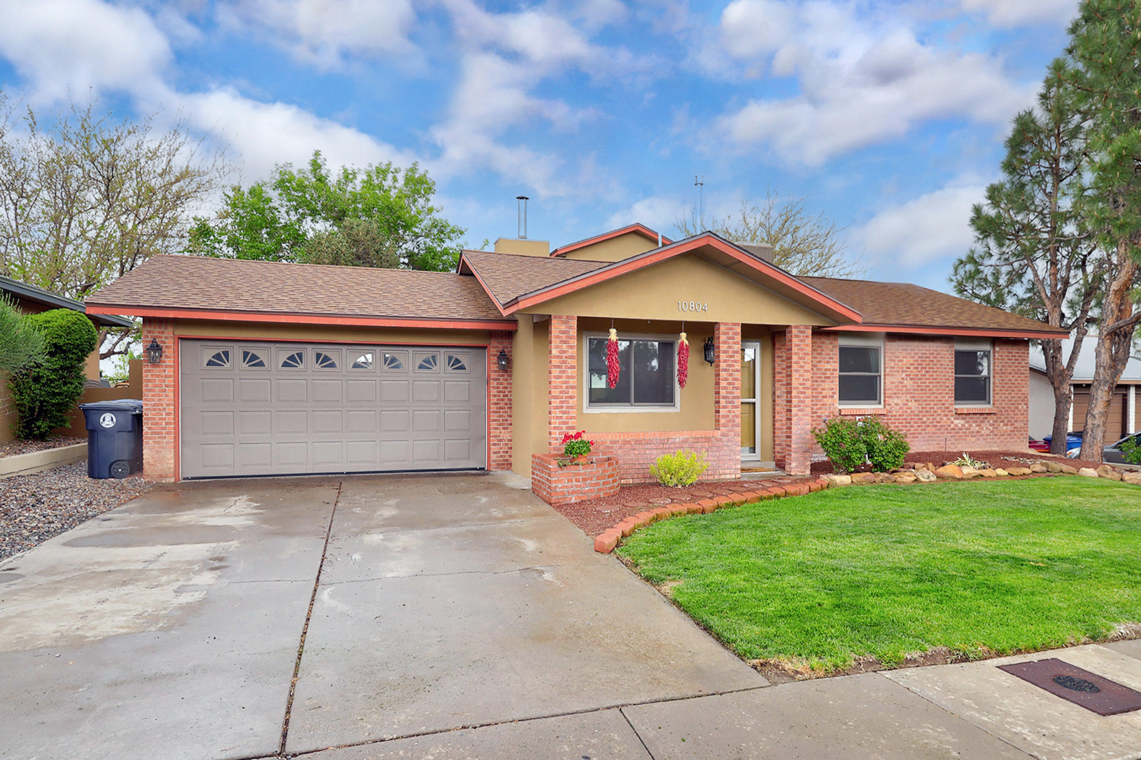So much to love- Delightful home with 4 bedrooms plus an office space.  Current owner did numerous updates and upgrades Pella windows (2015), New Breeeze Air Cooler & Heater (2015)- serviced annually by B Carlson,  Tankless water Heater (2019), Roof (2011), Synthetic Stucco 2016, Bamboo flooring throughout the home (except for kitchen and baths), updated bathrooms,  replaced interior  doors w solid wood doors.  This home is all on one level except for one bedroom upstairs with a mountain view! Beautifully landscaped yards- back has garden beds all on drip.  Hop the back wall to be at Eisenhower middle school.  Call for your private showing.