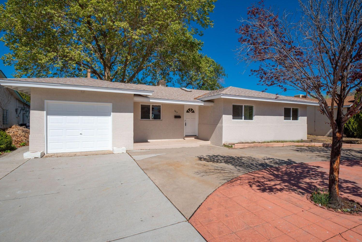 Beautifully remodeled home with tons of updates. This home features a brand new roof installed Oct 2020. New windows that bring in natural light throughout the home. New HVAC system and refrigerated air conditioning perfect for those NM summer days. New paint and vinyl flooring throughout. Oversized master with walk-in closet, master bath features a gorgeous vanity. Open remodeled kitchen with new appliances. Private low maintenance front and backyard with a lovely tree that shades your entire backyard.Screen for the fireplace has been ordered.