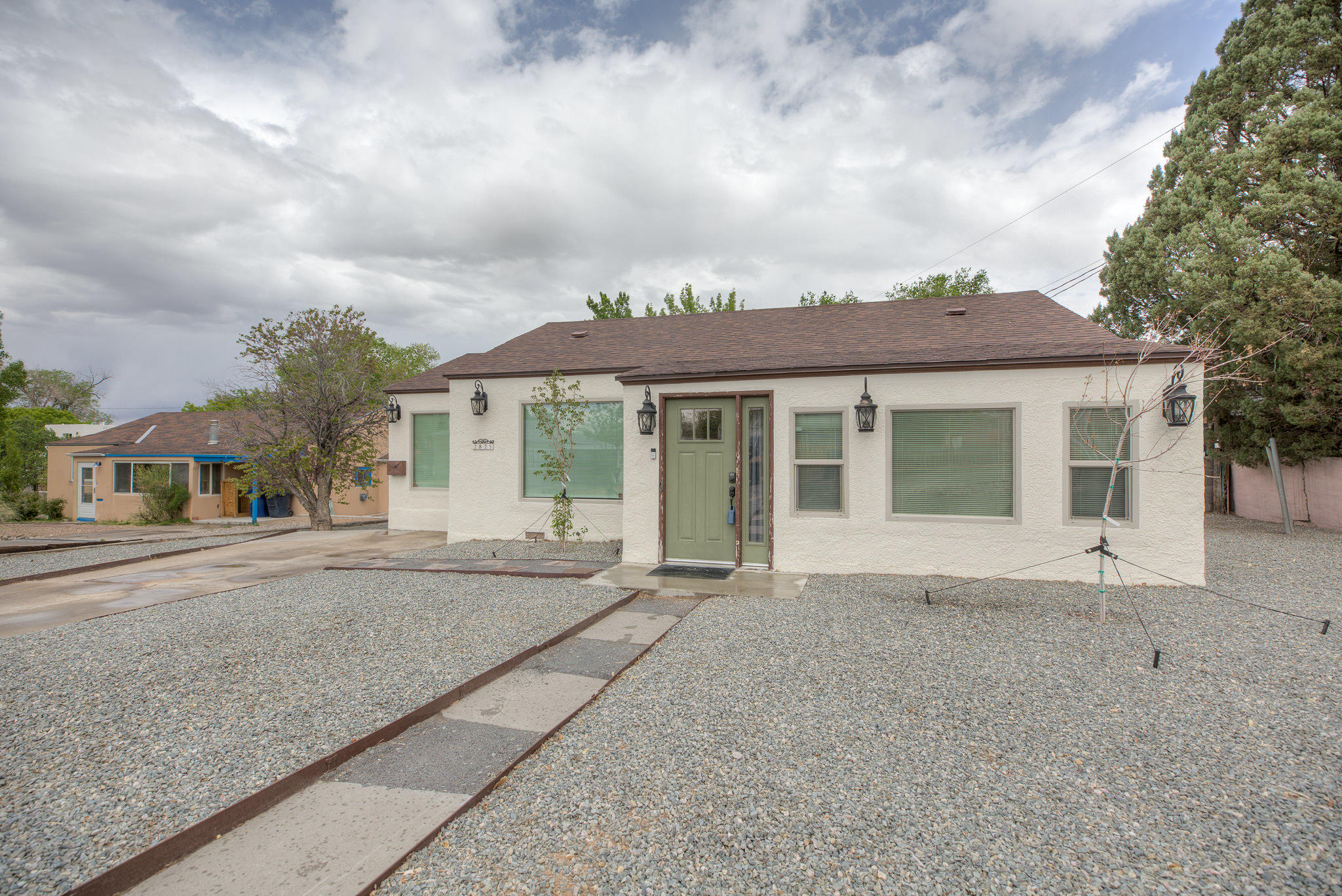 I'm really very cute! This updated home in the surrounding Nob Hill area will impress! Short distance to Hyder Park, UNM campus, Bandolier Elementary, Sandia Labs, Kirtland AFB, and local Hospitals. The Gourmet Kitchen is a wow factor with stainless steel appliances, granite countertops, new tile backsplash, new soft-close cabinets, original refinished wood floors, updated bathrooms, easy low maintenance landscaping, newer roof, updated plumbing and electrical, AC/heating combo units for temperature control and comfort! Large master suite with private deck is perfect for outdoor dining and relaxation! This home is a dream come true so don't wait another minute!