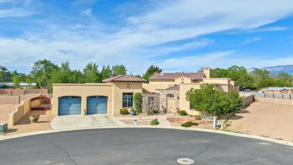 Exceptional, wonderfully located home with Sandia Mtn. views.  Easy walking access to the Los Poblanos Fields and the Bosque in a select north valley gated community. A virtual masterpiece of design which takes full advantage of Albuquerque's comfortable climate.  The chef's  gourmet kitchen includes full side by side Sub Zero refrigerator and freezer, a Wolf steam oven as well as a 6 burner gas/electric Wolf range.  Plus a Miele DW and a Sub Zero wine cooler.  The intimate breakfast courtyard with it's small fountain is the perfect spot to greet the morning and the lush backyard including a covered porch with grill and refrigerator is the perfect dinner venue to watch the setting sun bounce off the Sandias.  A rare opportunity not to be missed!