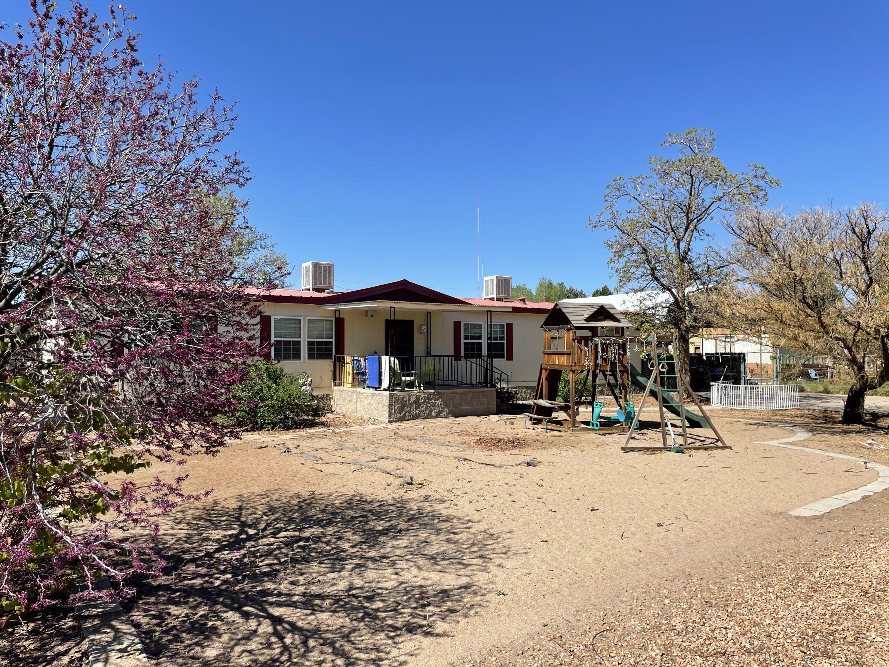 What an amazing opportunity to live in the North Valley on a half acre for under $150K! This 3 bed, 2 bath home has so much to offer - wide open living spaces, pellet stove, all appliances convey including 5-burner gas range, washer and dryer, plus an extra refrigerator, large pantry, walk-in closets in all rooms, lots of storage spaces, covered front porch, large sunroom on back of house, carport and the whole half acre is fully fenced. The views from the front porch are stunning - mountain views all year long plus a front row seat to the Balloon Fiesta and firework shows throughout the year. The possibilities are endless with this property, don't miss your chance to make this your new home!