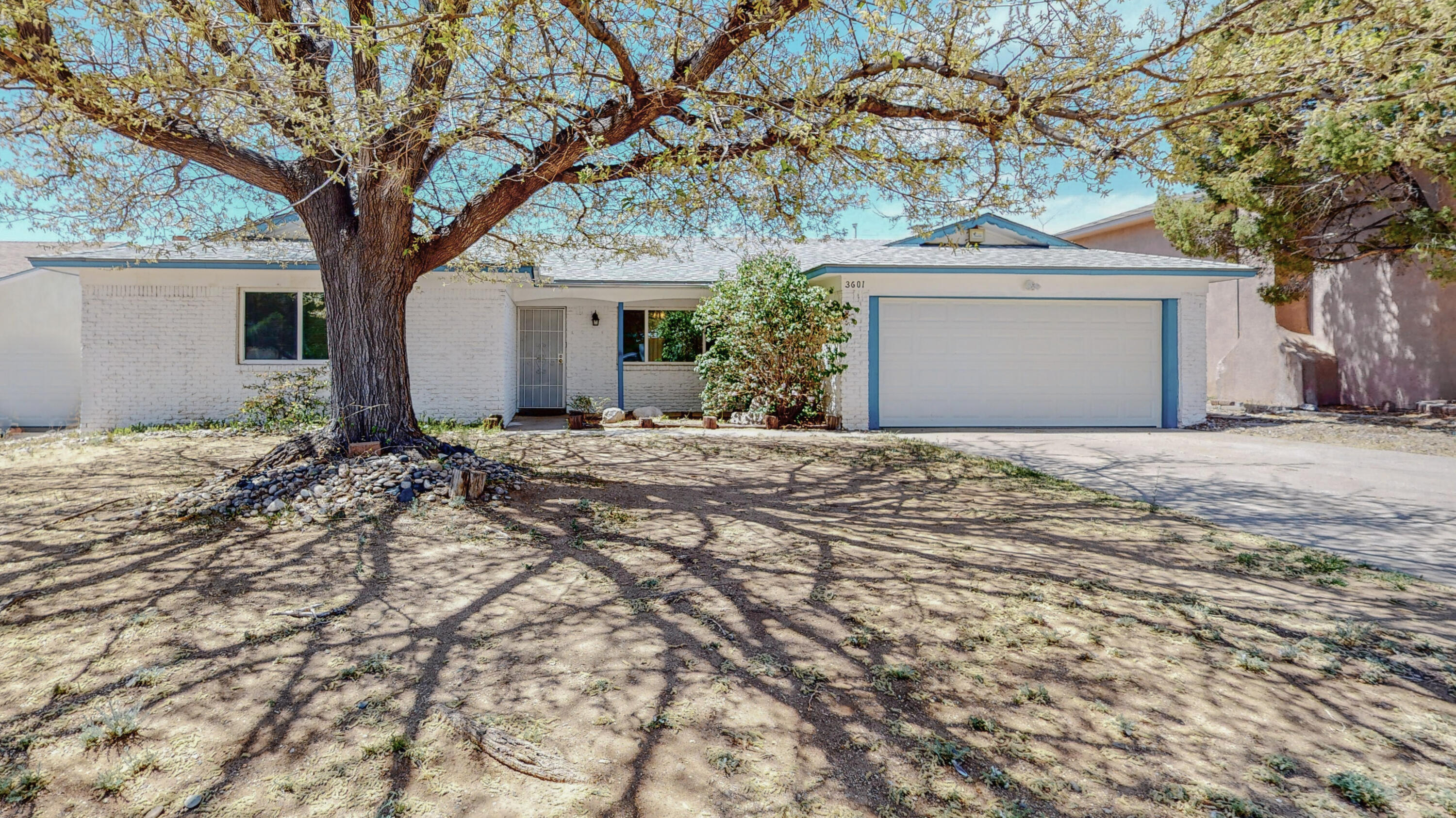 Highly sought after Holiday Park neighborhood. If you enjoy the outdoors, Piedra Lisa Canyon Trail is just minutes away. Have kids? Well this home is located in one of the best school districts in ABQ. John Baker Elementary and Hoover Middle school is just a walk out the backyard gate. This home is approx. 2,352sqft w/3 living areas and 4 generous sized bedrooms. Great for a large or extended family or maybe you're looking for a home to spread out in.The huge family room right off the kitchen is perfect for gatherings and entertaining. Travertine tile in front entry hallway, kitchen and laundry room. Kitchen and bathrooms updated in 2015. Furnace and MasterCool A/C less than 10yrs old. Garage door and opener 2019. NEW ROOF 2021 w/transferable warranty. Schedule a showing now