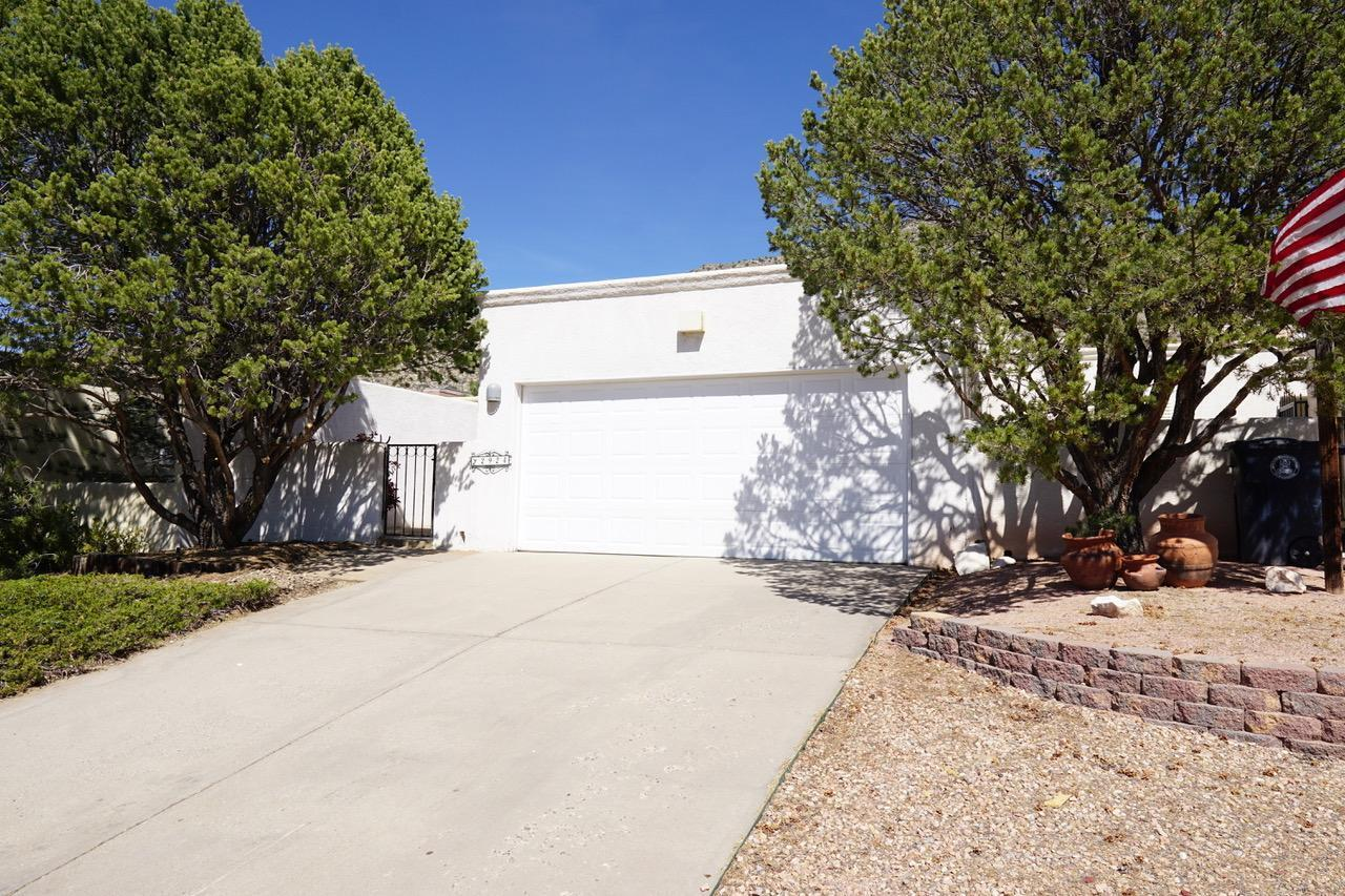 Beautifully remodeled 2 bedroom/possible 3 bedroom home. Nestled in the foothills of the Sandia Mountains. New lighting, fresh paint, and Granite accents throughout.  All new windows installed prior to closing.
