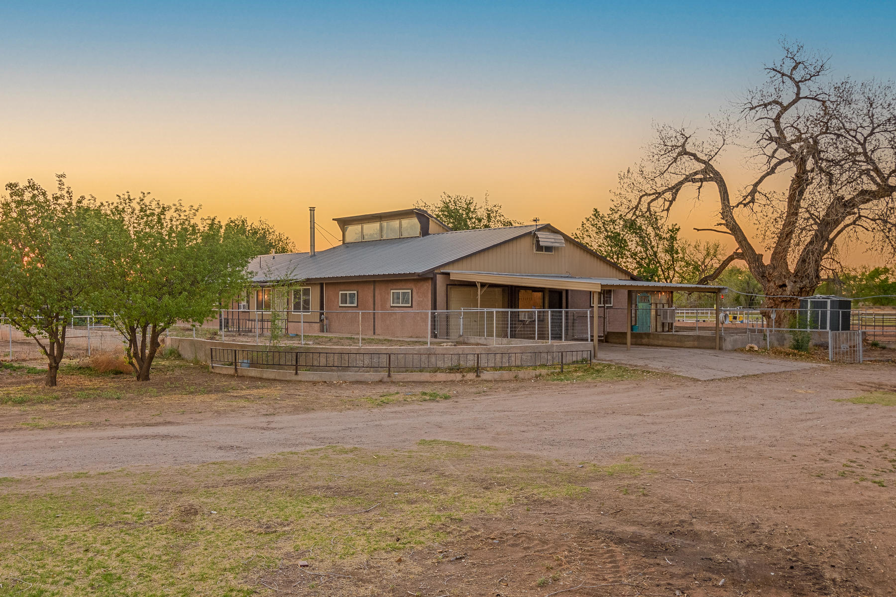 Come see this hidden jewel located in the beautiful South Valley. Just minutes to I-25 access and only 12 minutes from the Albuquerque Sunport. Enjoy the peace and quiet of country living on this full acre horse property with stalls, chicken coop and a huge workshop. The screened in patio will provide great enjoyment on warm summer nights. The outdoor kitchen stays! Home has a private and irrigation well. Application has been submitted to connect to the Los Padillas Drain for extra water usage. The uniquely built 3 bed 2 bad home lends itself to many options and opportunities. Schedule your tour today!!