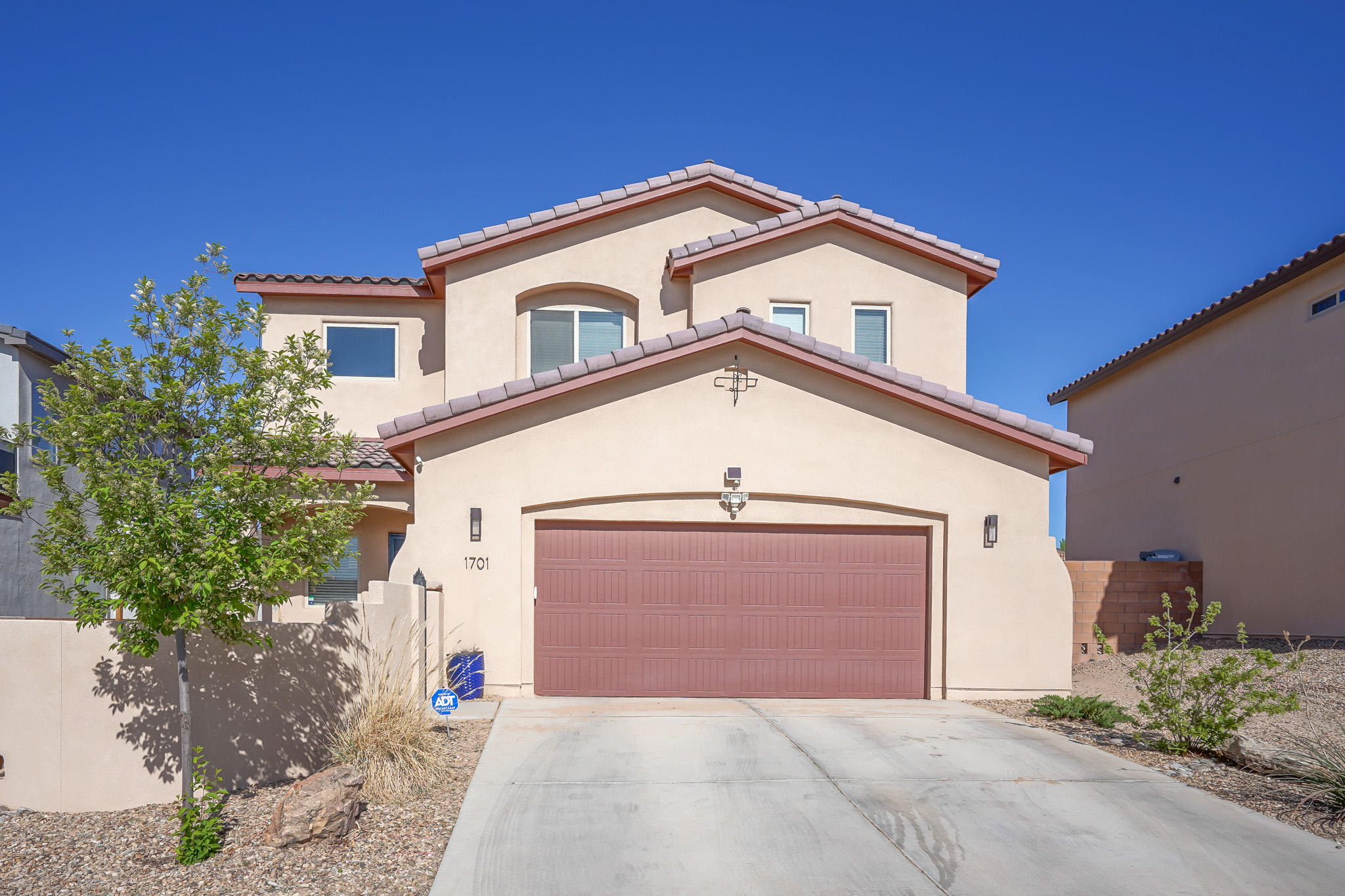 This is a beautiful two-story home with lovely curb appeal in Los Lunas,a few miles from I-25 for easy access. This home boasts an open floorplan & lots of natural lighting. All 3 bedrooms are upstairs along with 2 full baths, a loft area with breathtaking views of Tome hill & the Manzano Mountains. It's perfect for a cozy living room or office. The master boasts its own patio with spectacular views of Los Lunas Hill. The master bath has his & her sinks with separate bathtub/shower. The spacious kitchen comes equipped with  appliances, walk in pantry, granite countertops, and a long bar perfect for hosting your gatherings. The downstairs includes a half bath, under stairs storage, and oversized insulated garage with built in overhead storage. The yard has flowering bushes and vines.